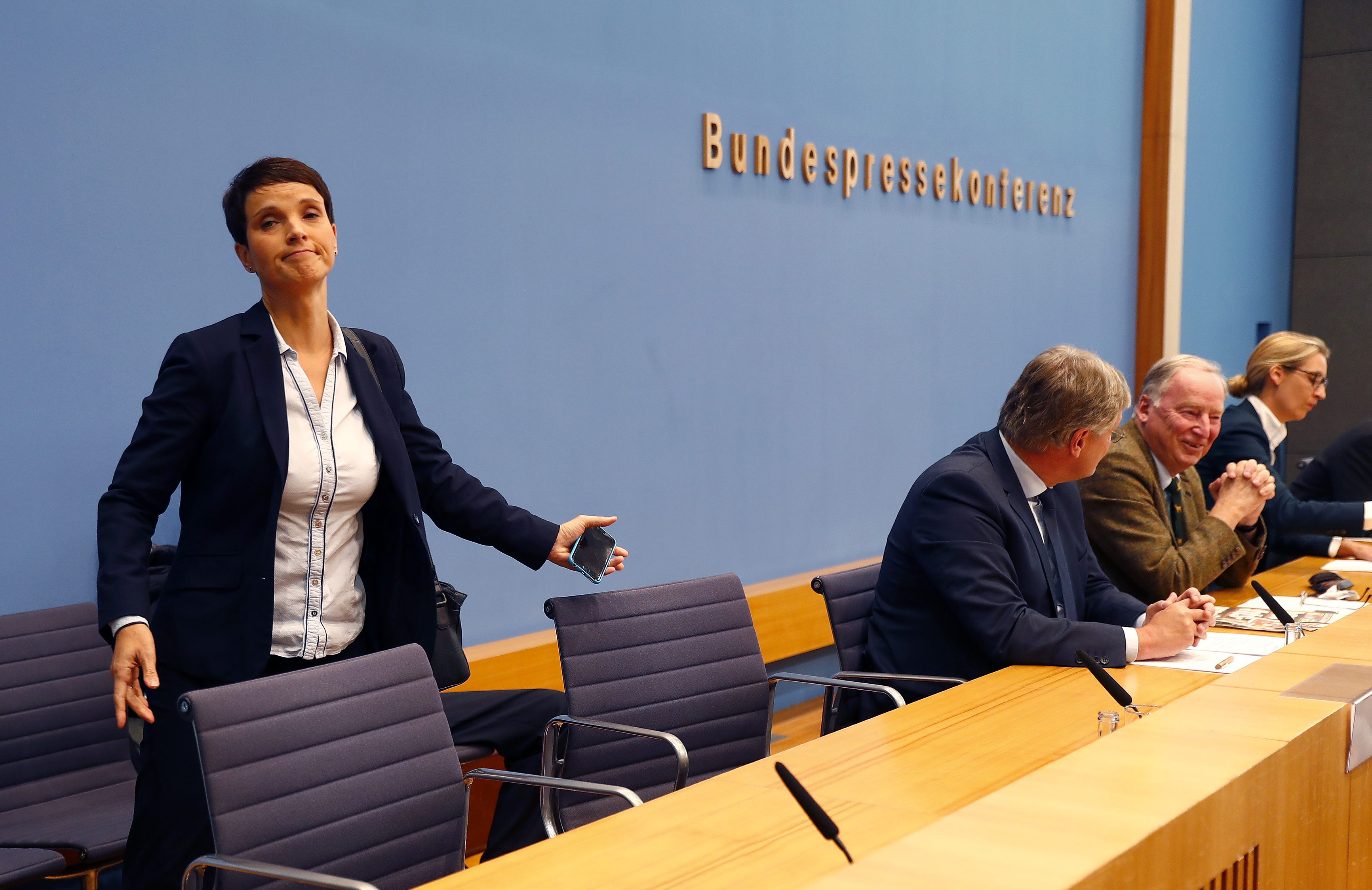 Frauke Petry, chairwoman of the anti-immigration party Alternative fuer Deutschland (AfD) leaves a news conference next to Joerg Meuthen (2nd L), leader of the party and  top candidates Alice Weidel (R) and Alexander Gauland in Berlin, Germany, September 25, 2017.