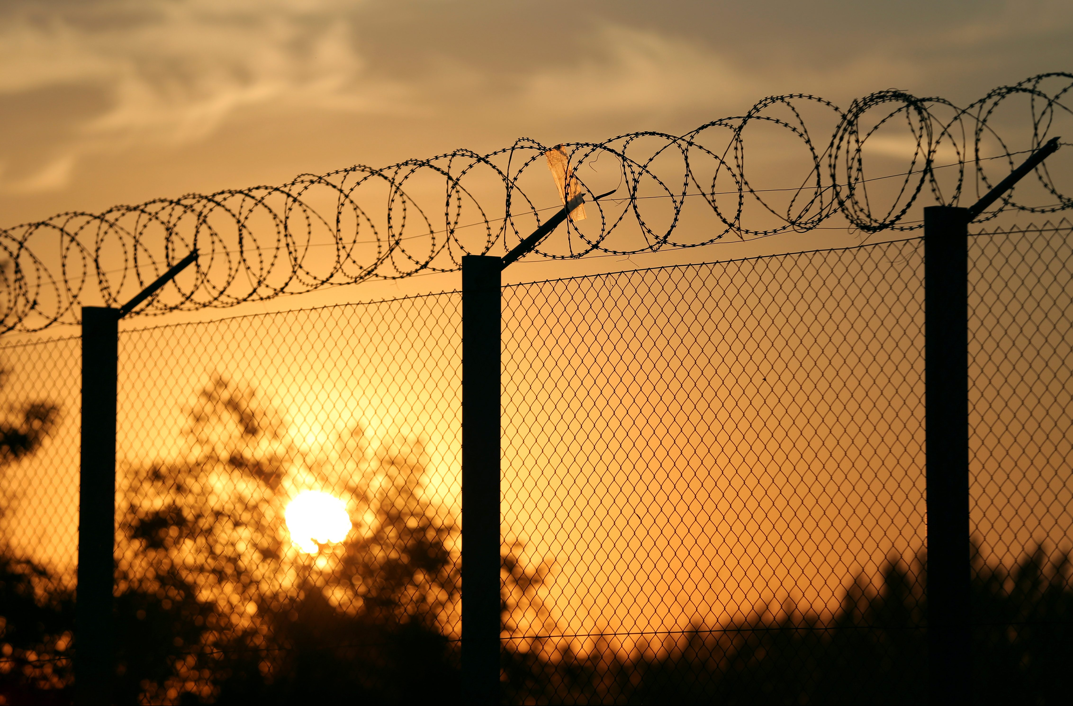 The Sun rises at the Hungary-Serbia border fence
