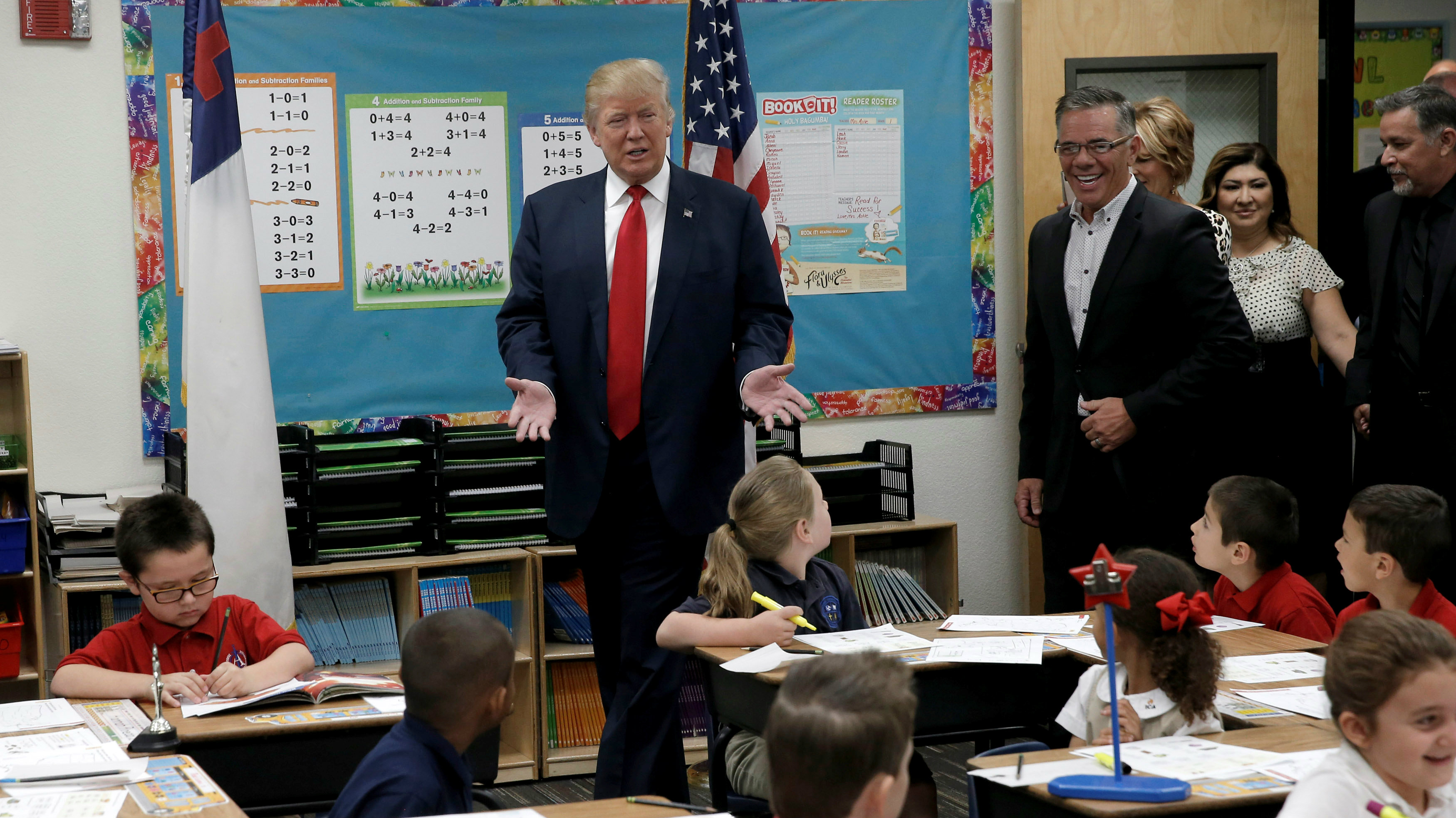 Republican presidential nominee Donald Trump visits children in a classroom during a campaign visit to.