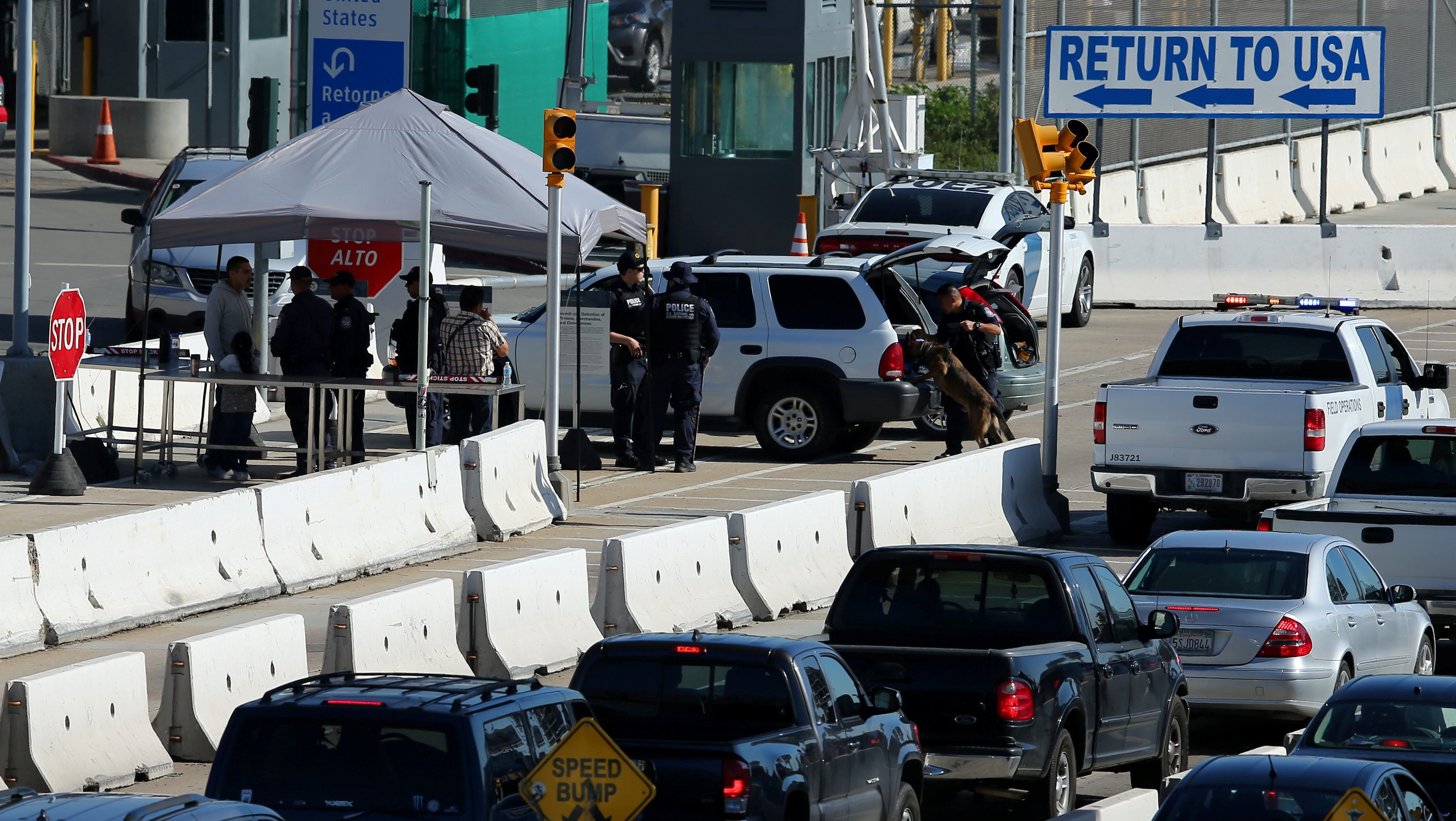 U.S. Customs and Border Patrol agents stop traffic heading into Mexico to check vehicles leaving the country in San Ysidro, California,