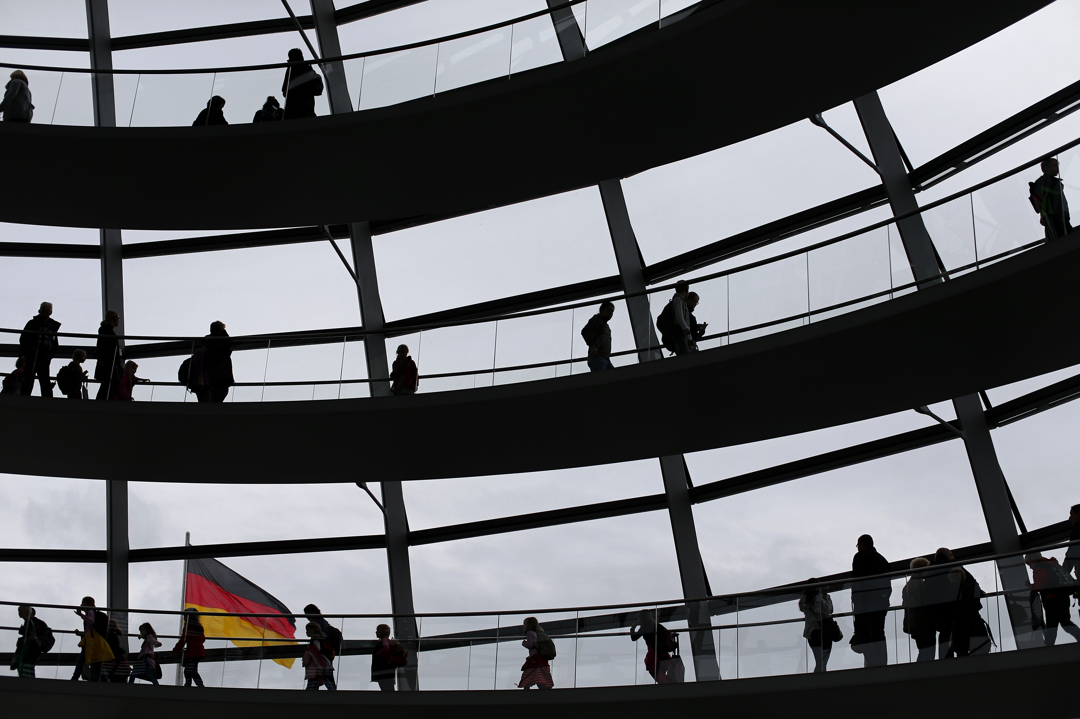 People walk inside the dome of the Reichstag building, the seat of the German lower house of parliament Bundestag in Berlin, September 16, 2013. German voters will take to the polls in a general election on September 22.