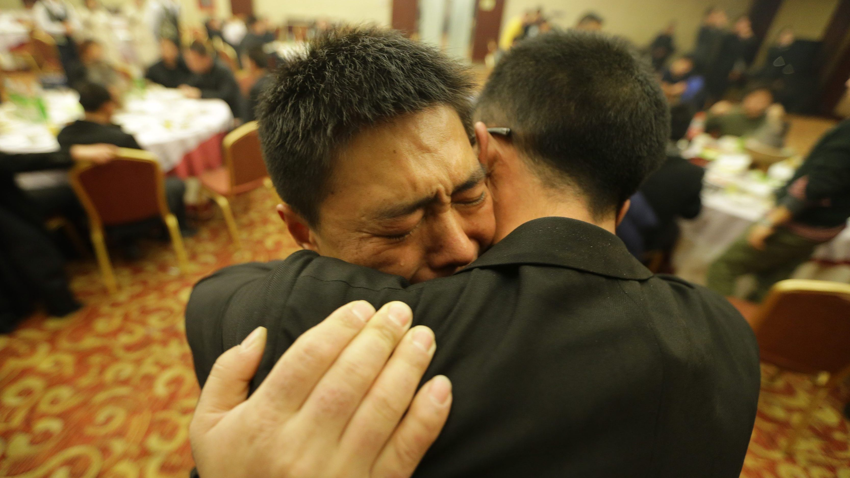 Students from the Tianjiao Special Guard/Security Consultant  bodyguard training hug and cry during a group dinner on the outskirts of Beijing, December 14, 2013. Former Chinese soldier Chen Yongqing has big ambitions for his bodyguard training school Tianjiao, which he says is China's first professional academy to train former soldiers and others as personal security guards.