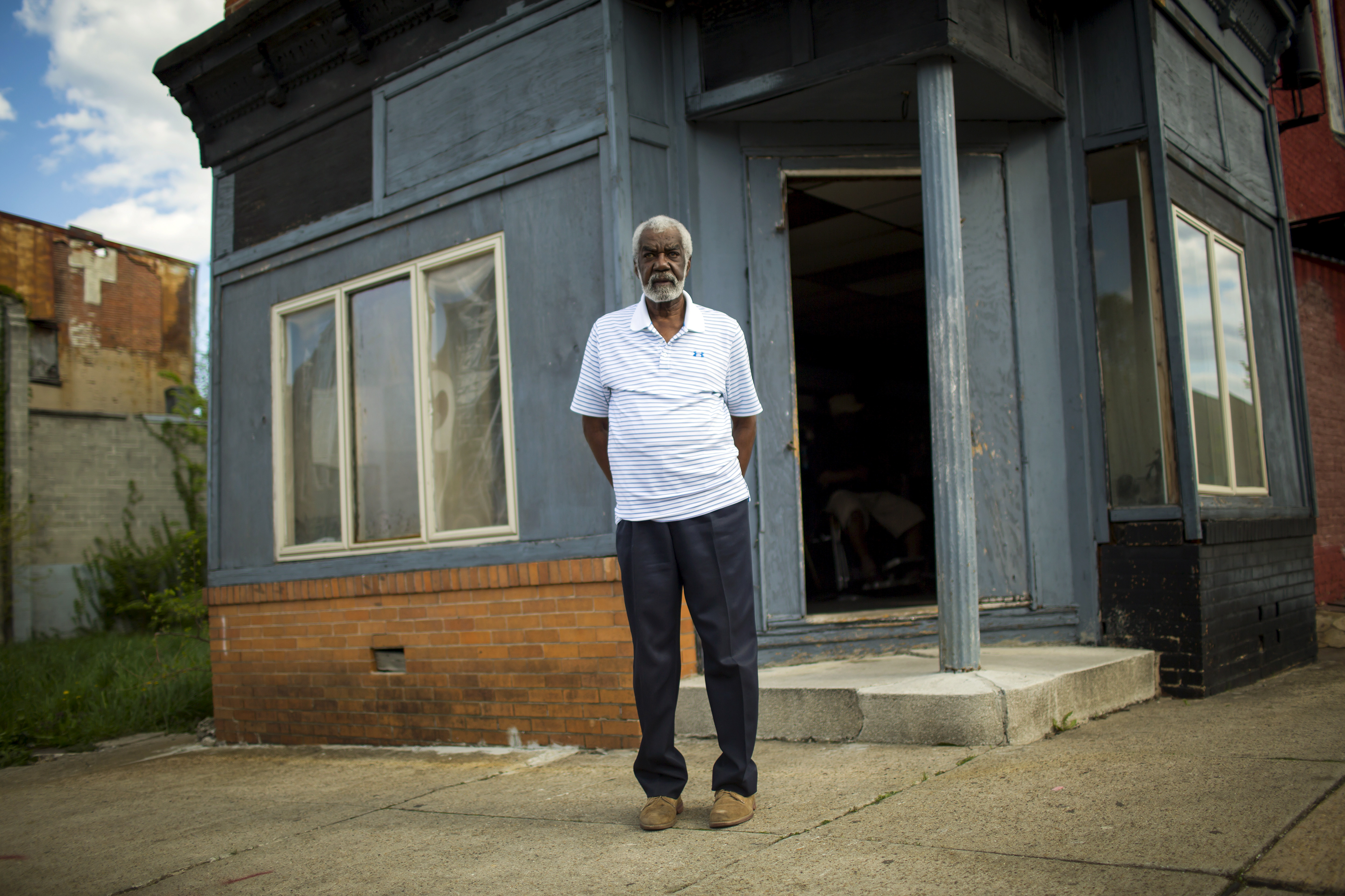 Lenny Clay stands outside his barbershop in Baltimore, Maryland April 29, 2015. In 1961, when Clay opened Lenny's House of Naturals in this corner storefront, the neighborhood was busy, bright, full of hard-working black families and black-owned businesses. And Clay's barbershop was at the center of things. Picture taken April 29. To match Insight USA-POLICE/BALTIMORE-BARBER   - GF10000078243