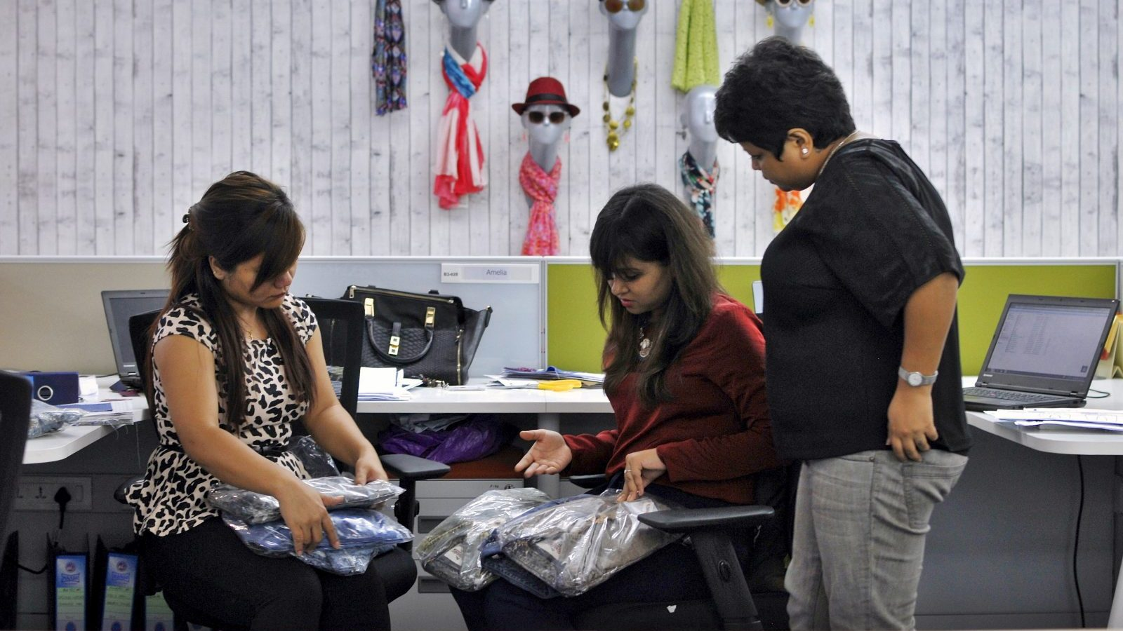Employees inspect apparel packaging before shipping, in Myntra's office in Bengaluru, India, May 6, 2015. India's biggest online fashion retailer, Myntra, could turn profitable within a year or two as it cuts back on bargains, improves its mobile shopping app and pushes more of its own label garments, a top executive said. Picture taken May 6, 2015. To match story INDIA-MYNTRA/ REUTERS/Abhishek N. Chinnappa - GF10000087939