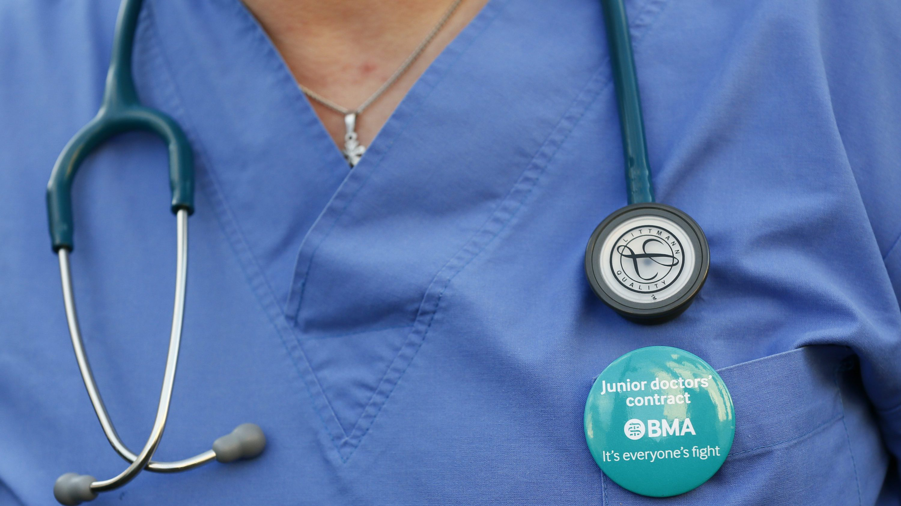 A doctor wears her stethoscope around her neck during a strike outside St Thomas' hospital in central London, Britain January 12, 2016. English doctors staged their first strike in 40 years on Tuesday over government plans to reform pay and conditions for working anti-social hours, in a move health chiefs have warned could put patients' lives at risk.