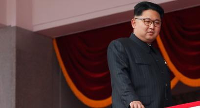 North Korean leader Kim Jong Un looks from the balcony as he presides over a mass rally and parade in the capital's main ceremonial square, a day after the ruling party wrapped up its first congress in 36 years by elevating him to party chairman, in Pyongyang, North Korea May 10, 2016.