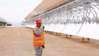 A security guard stands near the thermosolar power plant at Noor II, northeast of the city of Ouarzazate, Morocco, November 4, 2016. Picture taken November 4, 2016.