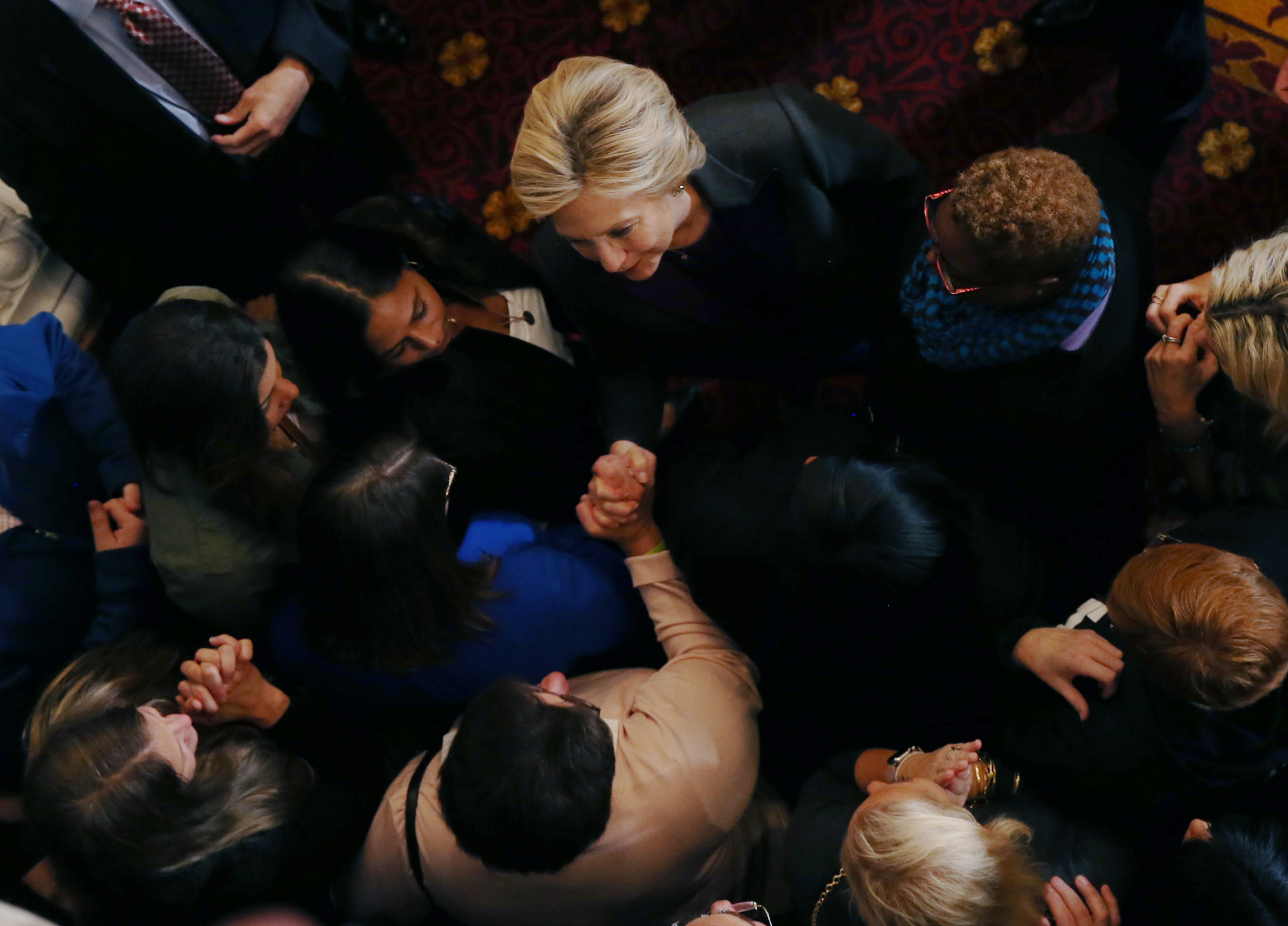 Hillary Clinton speaks with staff and supporters after a speech about the results of the U.S. election at a hotel in New York, November 9, 2016. REUTERS/Carlos Barria  - HT1ECB91D6U7U