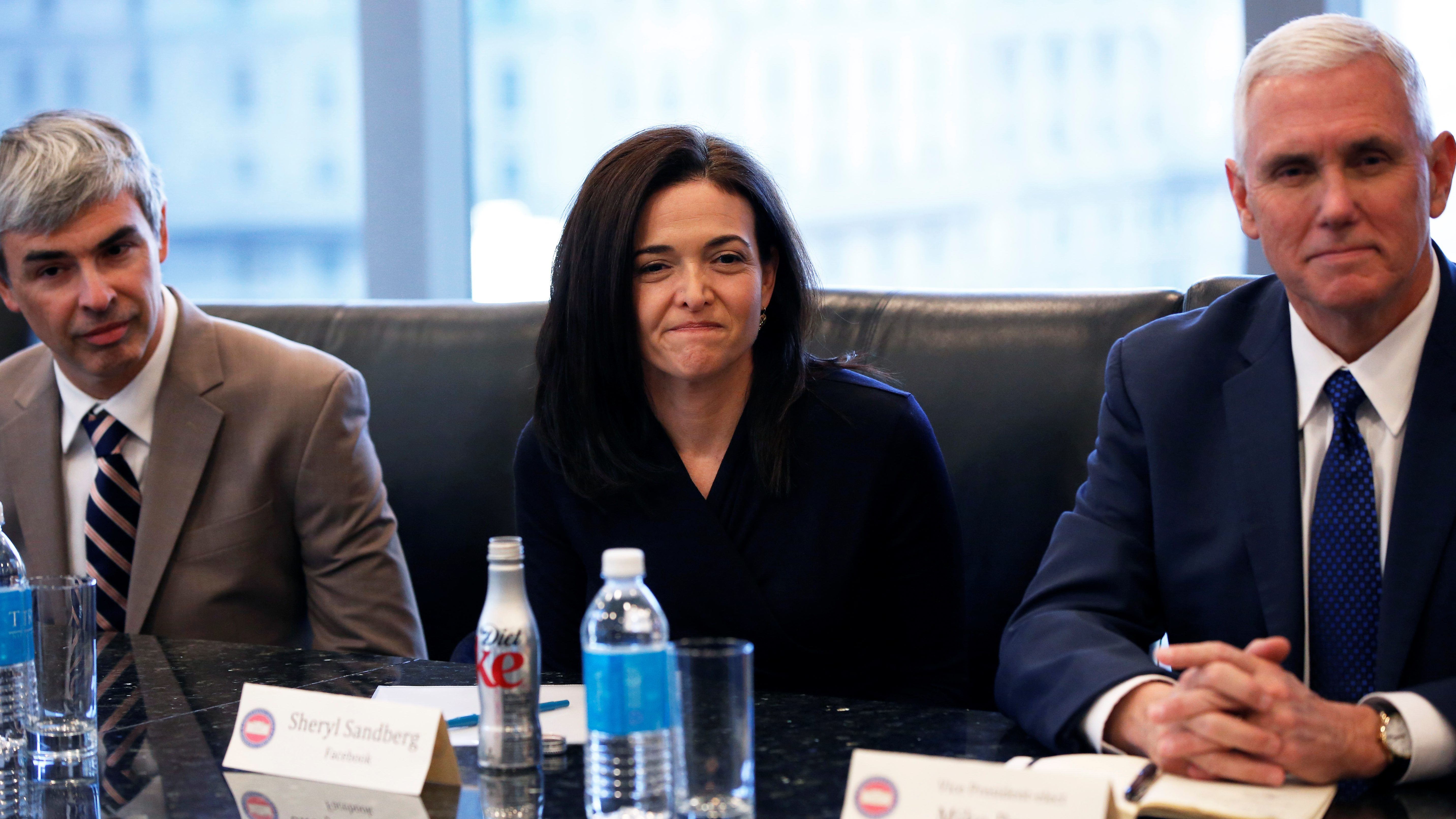 (L-R) Larry Page, CEO and Co-founder of Alphabet, Sheryl Sandberg, Chief Operating Officer of Facebook, and Vice President-elect Mike Pence sit during a meeting with U.S. President-elect Donald Trump and technology leaders at Trump Tower in New York U.S., December 14, 2016. REUTERS/Shannon Stapleton - RC110E33BD00
