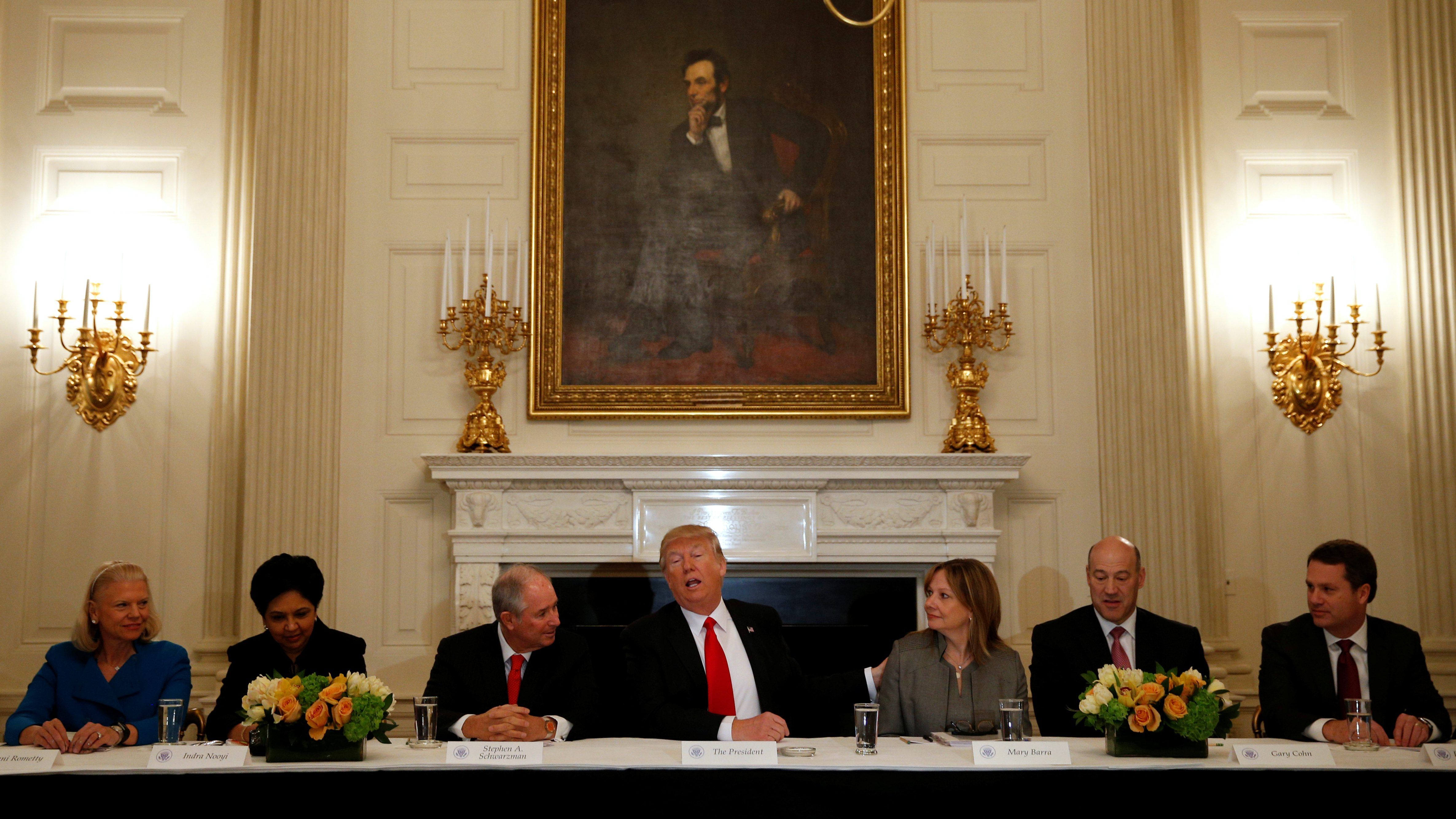 U.S. President Donald Trump puts his hand on General Motors CEO Mary Barra while hosting a strategy and policy forum with chief executives of major U.S. companies at the White House in Washington, U.S. February 3, 2017. From L-R are IBM CEO Ginni Rometty, Pepsico CEO Indra Nooyi, Blackstone CEO Stephen Schwarzman, U.S. President Donald Trump, General Motors CEO Mary Barra, White House National Economic Council Director Gary Cohn and Wal-Mart CEO Doug McMillon.      TPX IMAGES OF THE DAY - RC11FFB7FB60