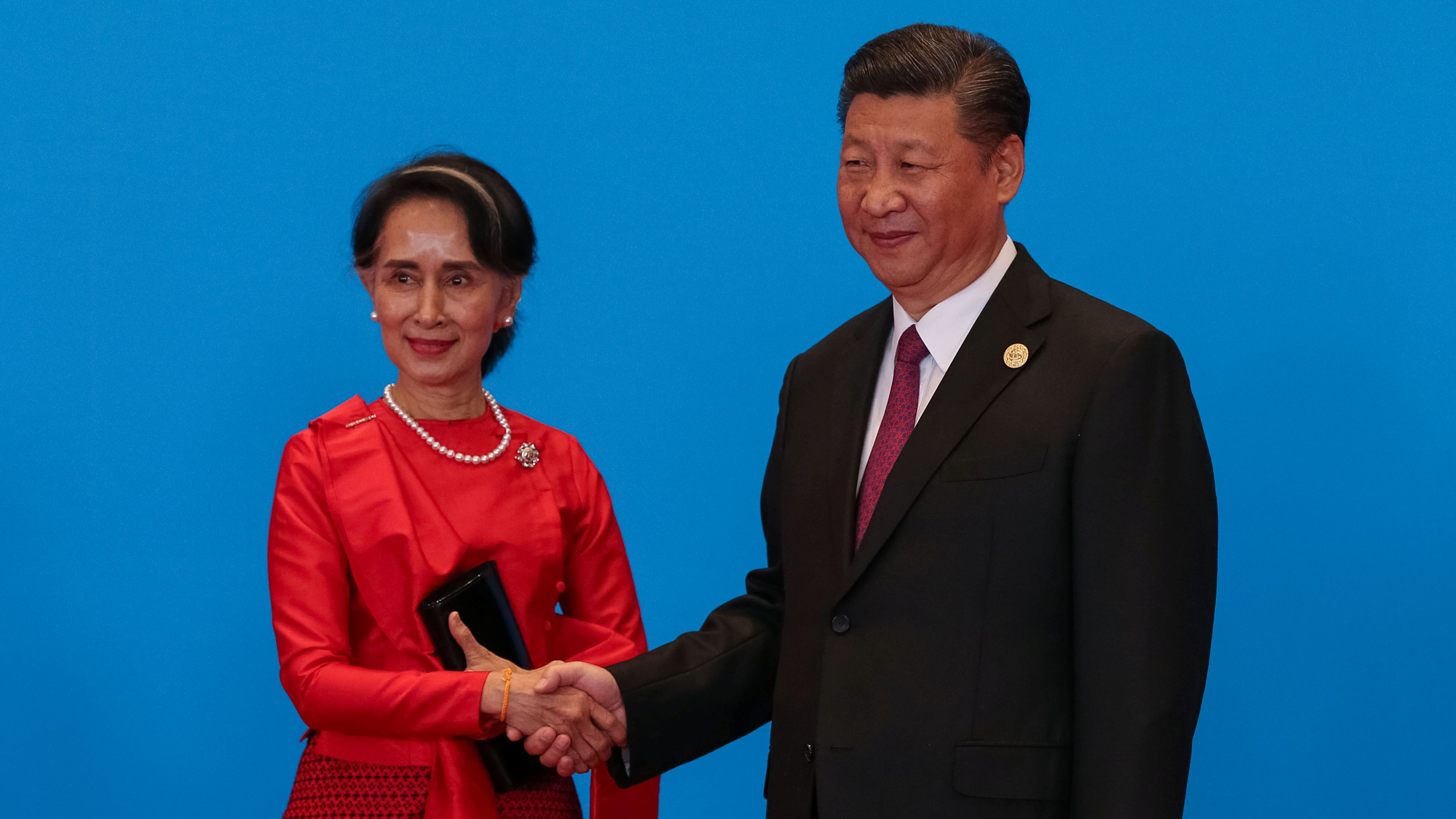 Chinese President Xi Jinping (R) shakes hands with Myanmar's State Counsellor Aung San Suu Kyi as they attend the welcome ceremony at Yanqi Lake during the Belt and Road Forum, in Beijing, China, May 15, 2017.