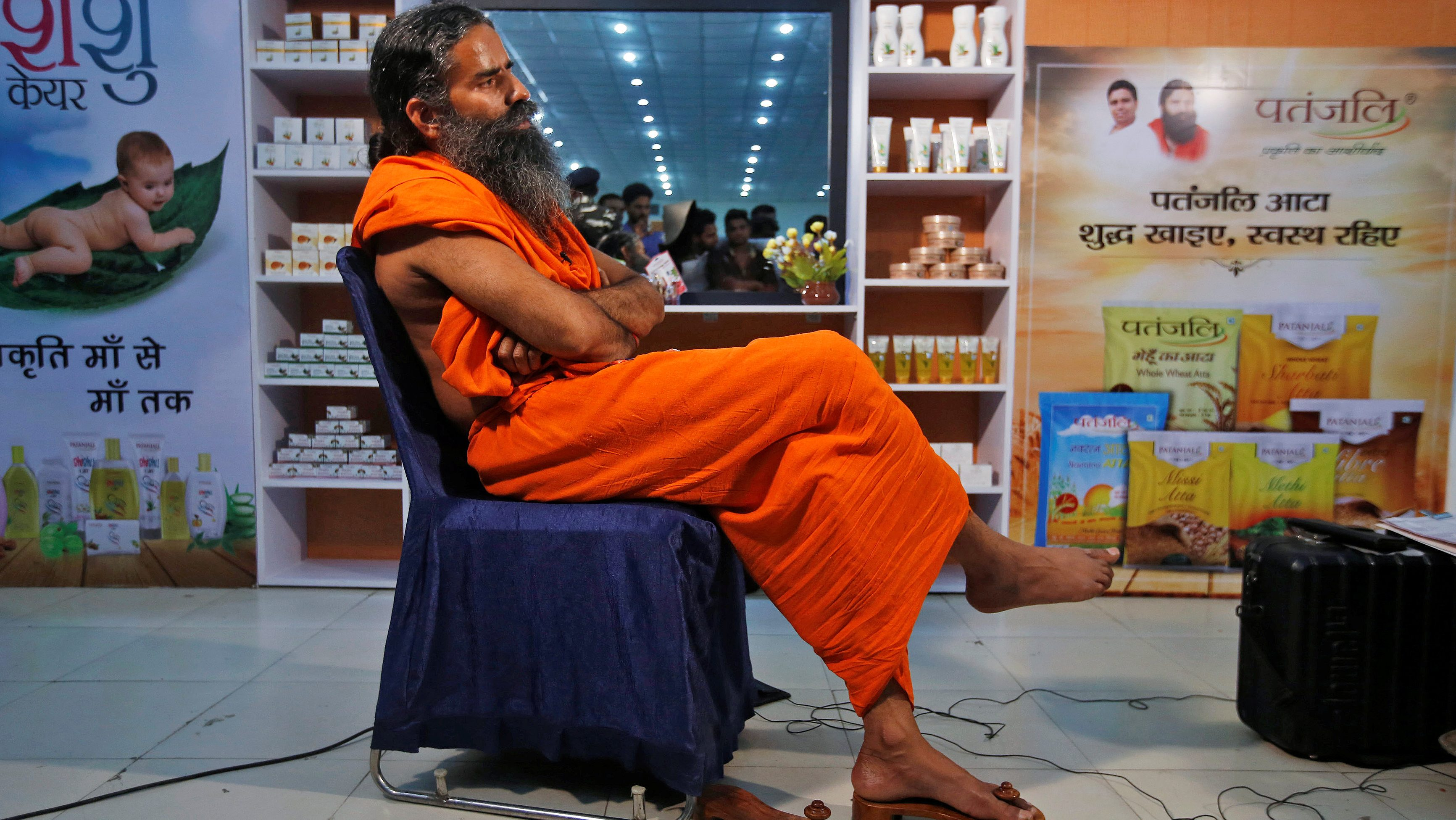 Indian yoga guru Baba Ramdev talks to media after a news conference in New Delhi, India, May 4, 2017. Picture taken on May 4, 2017. To match Special Report INDIA-MODI/RAMDEV      REUTERS/Adnan Abidi - RC1F70791F90