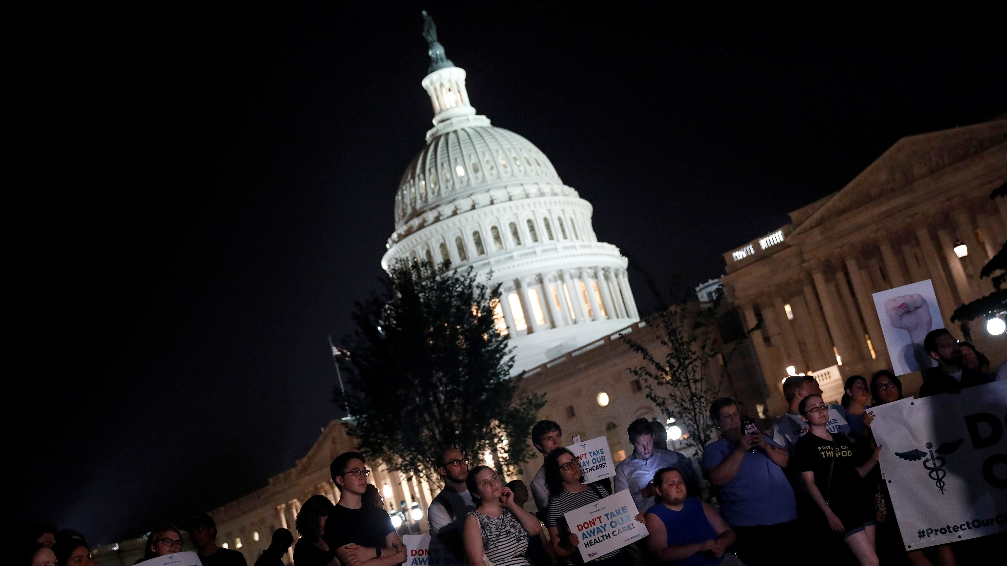 Protesters gather outside the Capitol Building prior to an all night round of health care votes on Capitol Hill in Washington