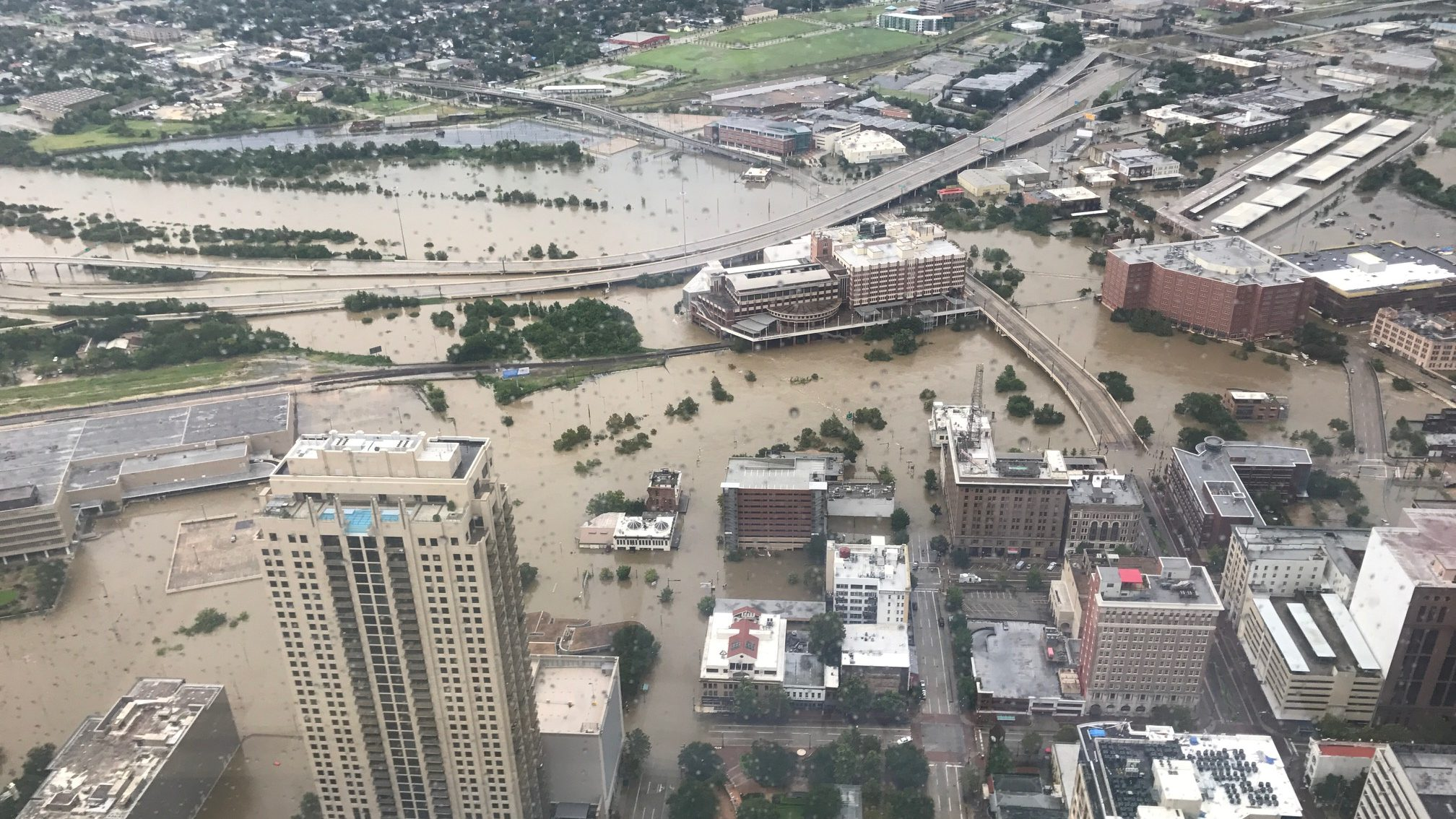 Flooded downtown is seen from JP Morgan Chase Tower after Hurricane Harvey inundated the Texas Gulf coast with rain causing widespread flooding, in Houston, Texas, U.S. August 27, 2017 in this picture obtained from social media. Mandatory credit: Christian Tycksen via REUTERS ATTENTION EDITORS - THIS IMAGE HAS BEEN SUPPLIED BY A THIRD PARTY. MANDATORY CREDIT. NO RESALES. NO ARCHIVES - RC1806C16EF0