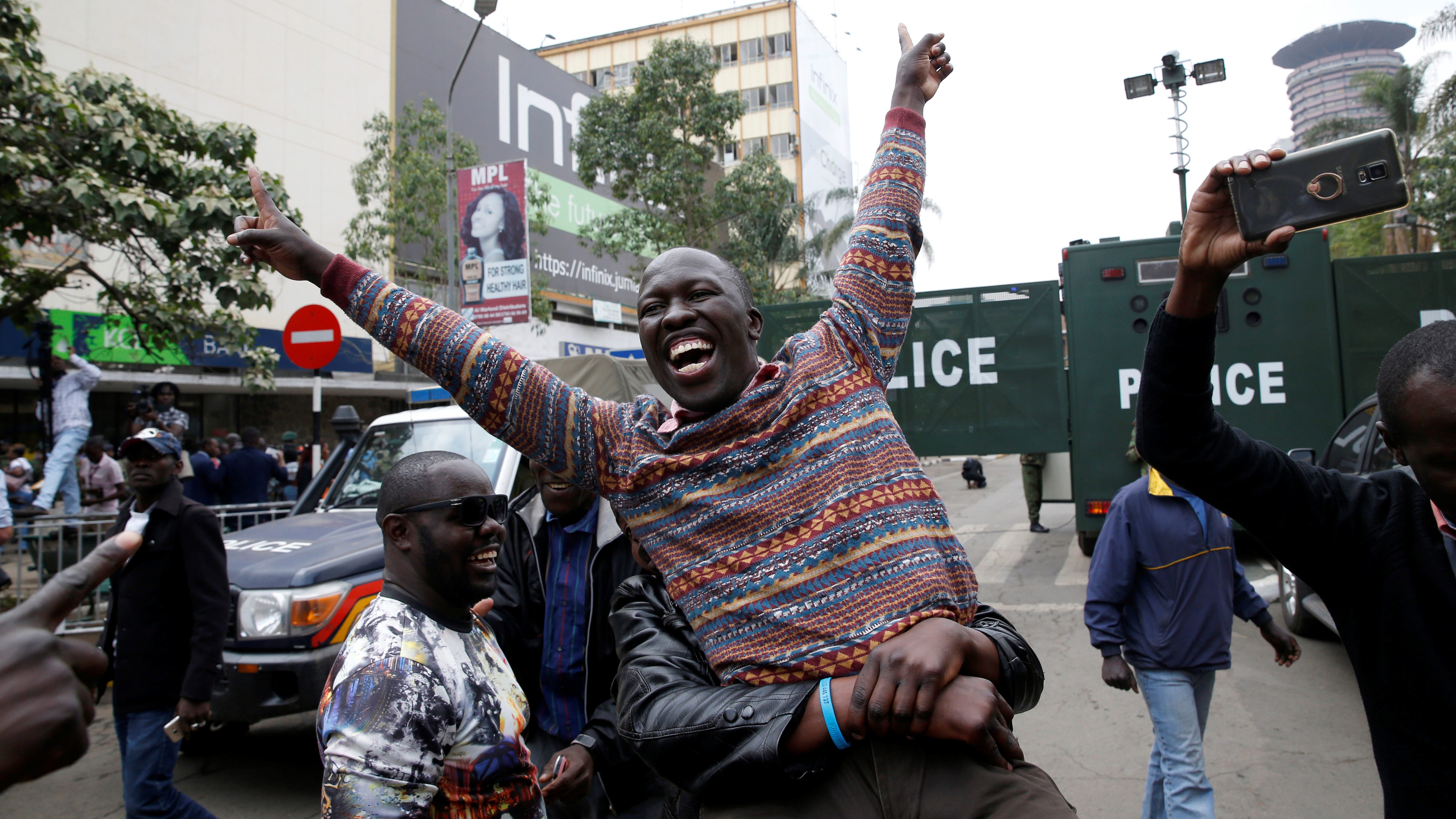 Supporters of an opposition leader Raila Odinga cheer outside the court after President Uhuru Kenyatta's election win was declared invalid in Nairobi, Kenya, September 1,