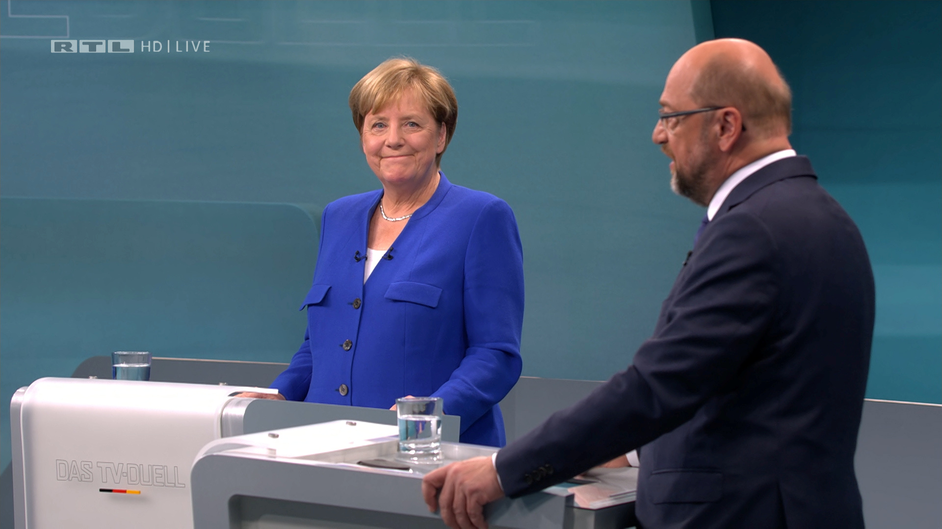 A screen that shows the TV debate between German Chancellor Angela Merkel of the Christian Democratic Union (CDU) and her challenger Germany's Social Democratic Party SPD candidate for chancellor Martin Schulz in Berlin, Germany, September 3, 2017. German voters will take to the polls in a general election on September 24. Mediengruppe RTL Deutschland (MG RTL D)/Handout via REUTERS ATTENTION EDITORS - THIS IMAGE WAS PROVIDED BY A THIRD PARTY. NO RESALES. NO ARCHIVE. - RC1BFE3B1EB0