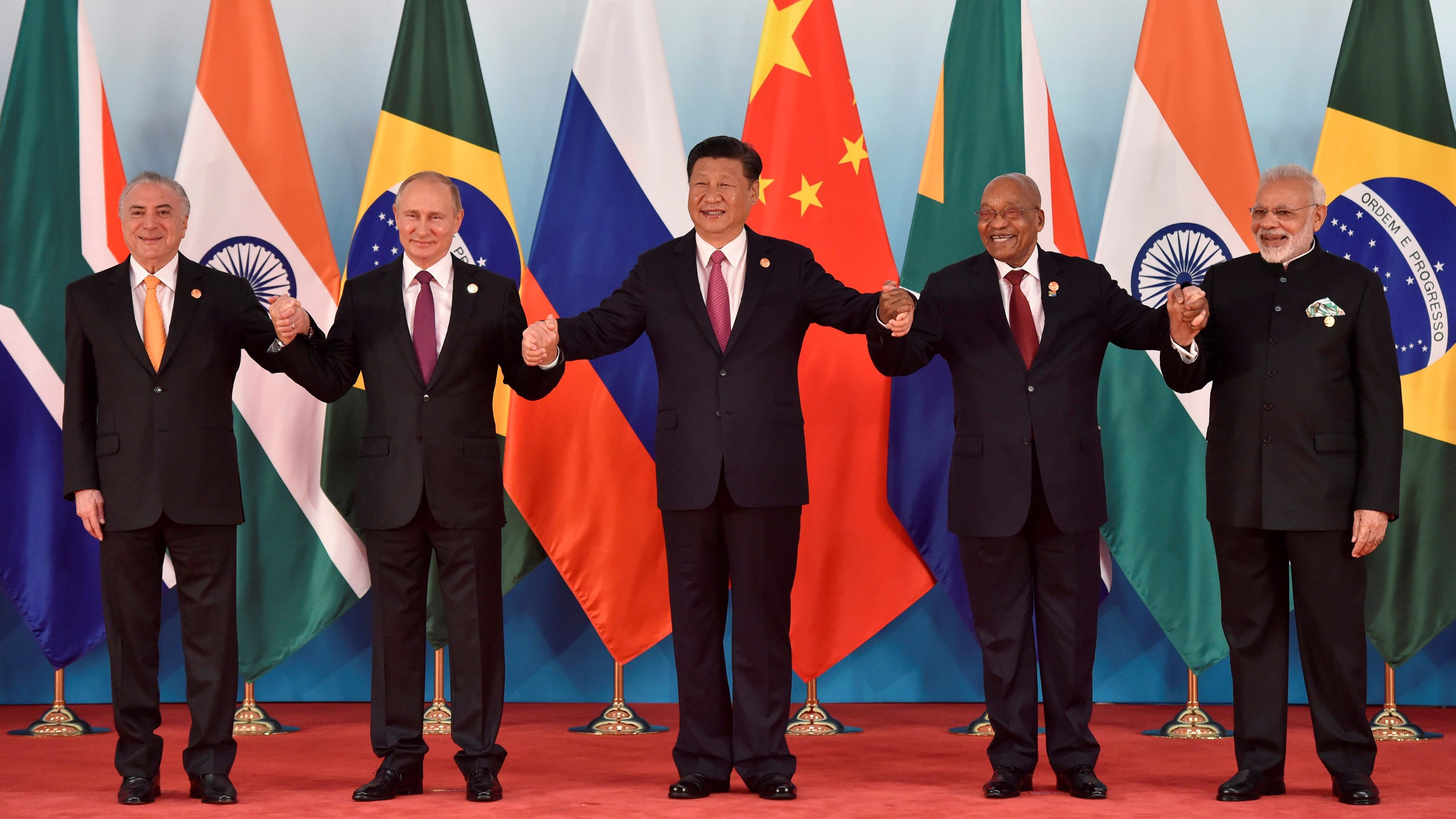 (L-R) Brazil's President Michel Temer, Russian President Vladimir Putin, Chinese President Xi Jinping, South Africa's President Jacob Zuma and Indian Prime Minister Narendra Modi pose for a group photo during the BRICS Summit at the Xiamen International Conference and Exhibition Center in Xiamen, southeastern China's Fujian Province, China September 4, 2017.