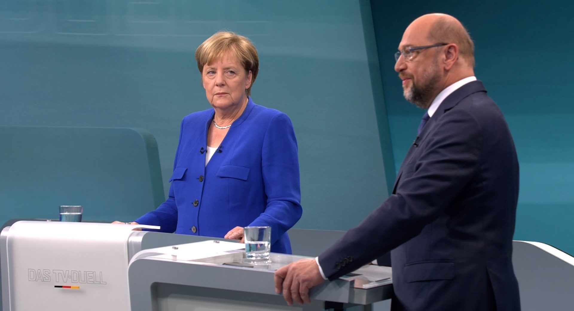 A screen that shows the TV debate between German Chancellor Angela Merkel of the Christian Democratic Union (CDU) and her challenger Germany's Social Democratic Party SPD candidate for chancellor Martin Schulz in Berlin, Germany, September 3, 2017. German voters will take to the polls in a general election on September 24.