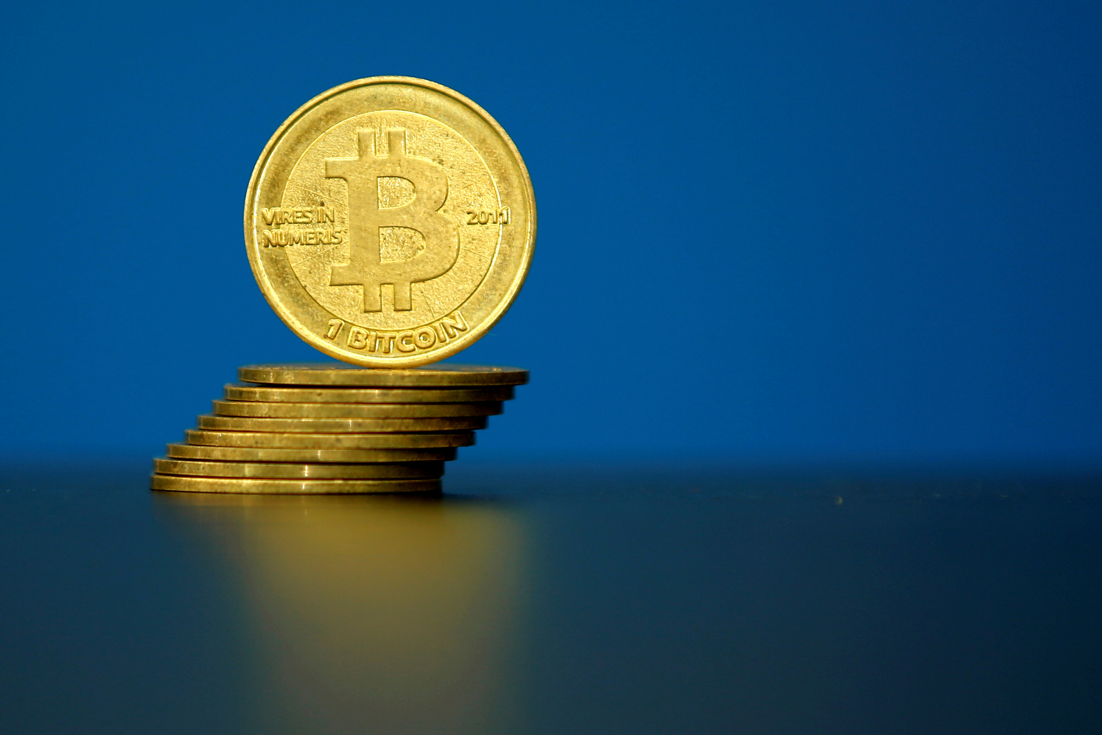 FILE PHOTO: Bitcoin (virtual currency) coins are seen in an illustration picture taken at La Maison du Bitcoin in Paris, France, May 27, 2015.