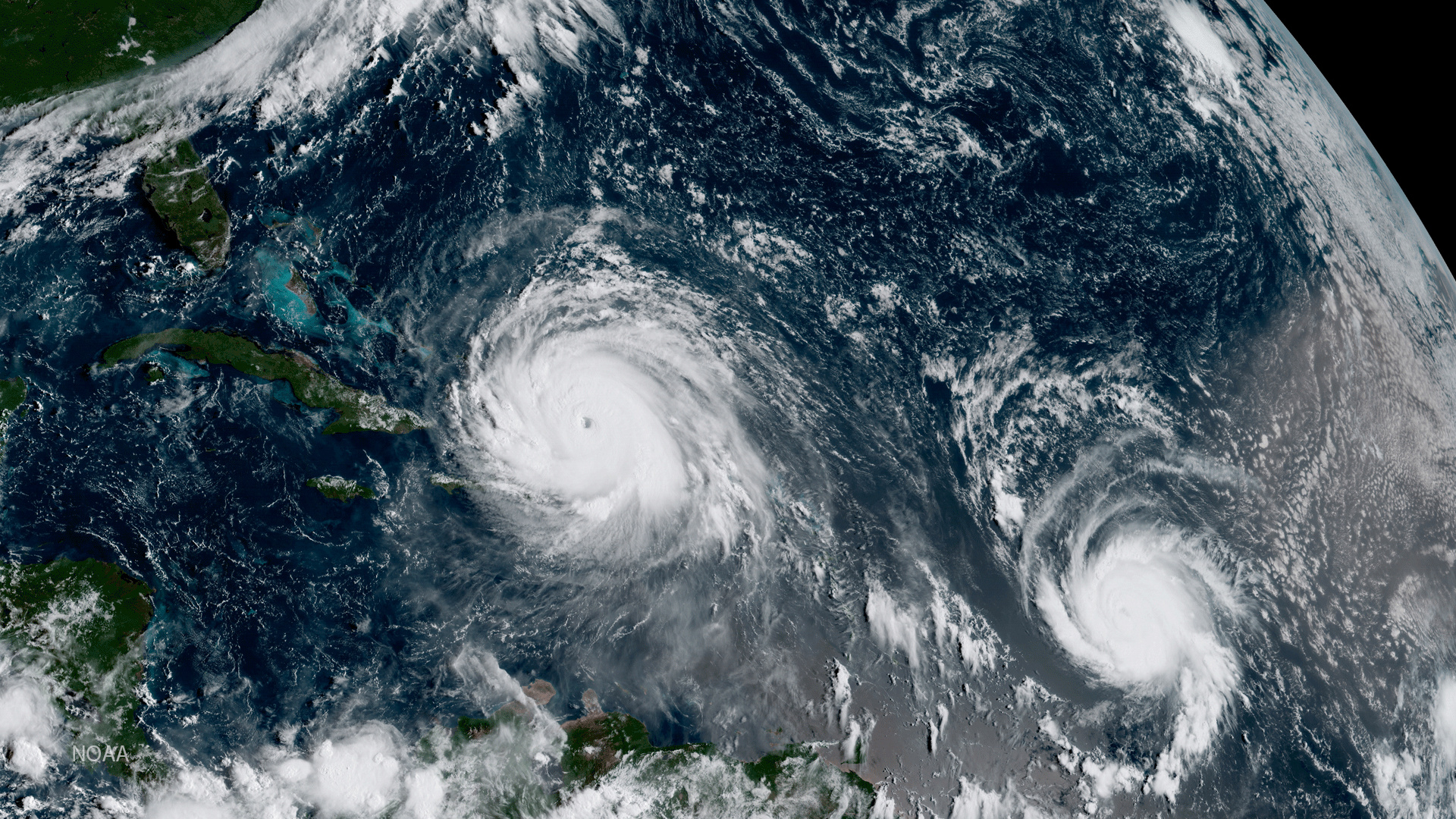 Hurricane Irma (L) and Hurricane Jose are pictured  in the Atlantic Ocean in this September 7, 2017 NOAA satellite handout photo. NOAA/Handout via REUTERS    ATTENTION EDITORS - THIS IMAGE WAS PROVIDED BY A THIRD PARTY. - RC1B4FFD9AD0