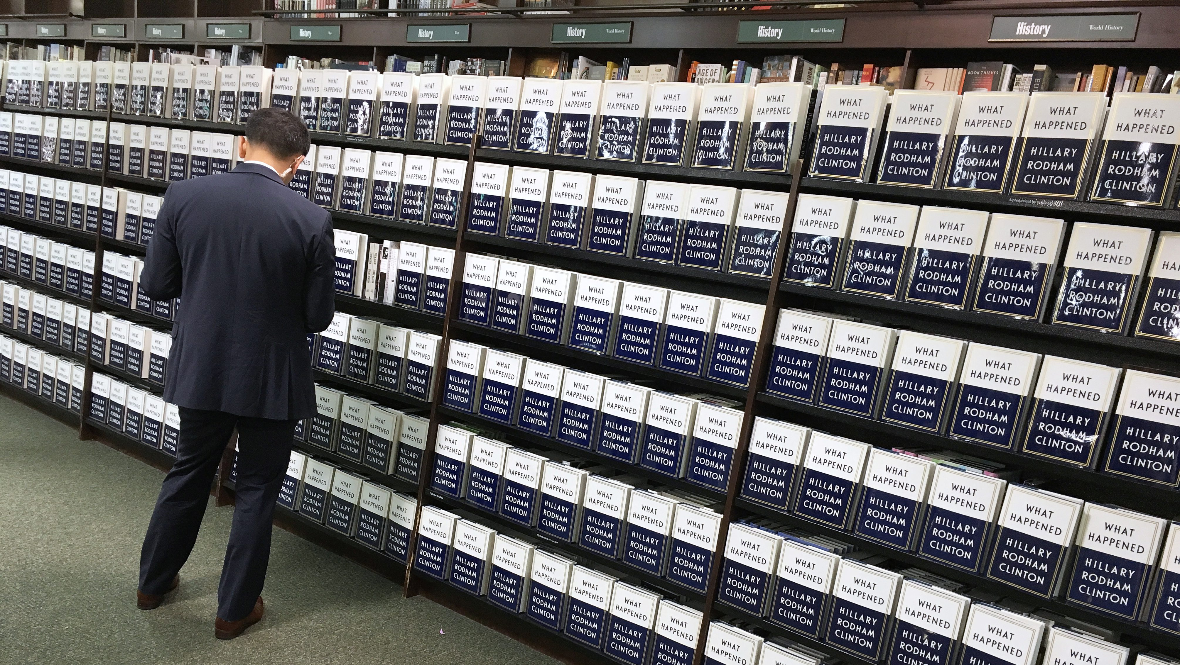 """Copies of Hilary Clinton's new book """"What Happened"""" line shelves before she arrives for a book signing in Barnes & Noble Union Square in Manhattan, New York, US September 12 2017.  REUTERS/Andrew Kelly - RC16FA6E68D0"""