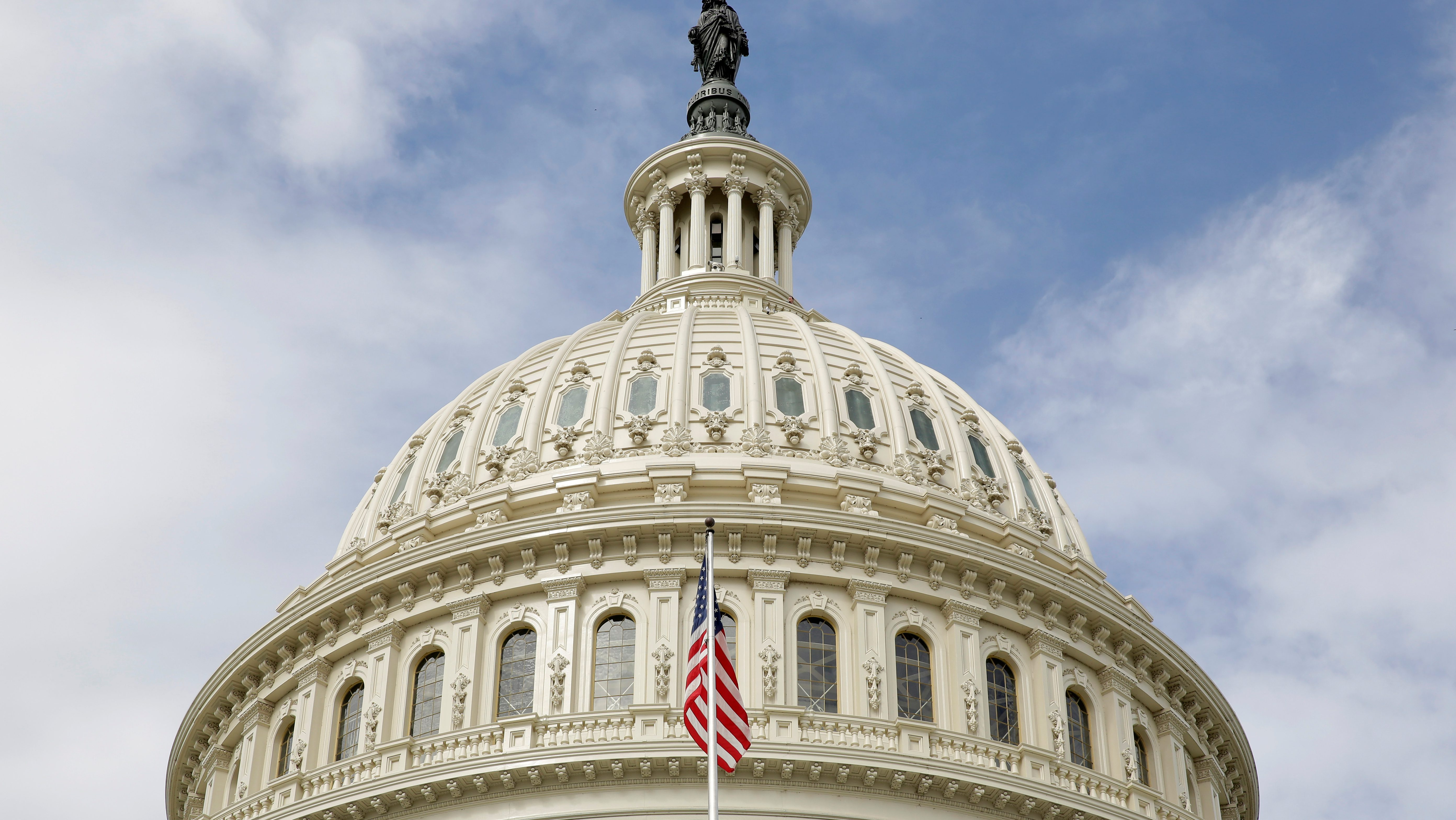 The U.S. flag flies in front of the Capitol Dome at the U.S. Capitol in Washington