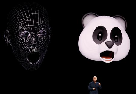 Apple Senior Vice President of Worldwide Marketing, Phil Schiller, shows Animoji during a launch event.