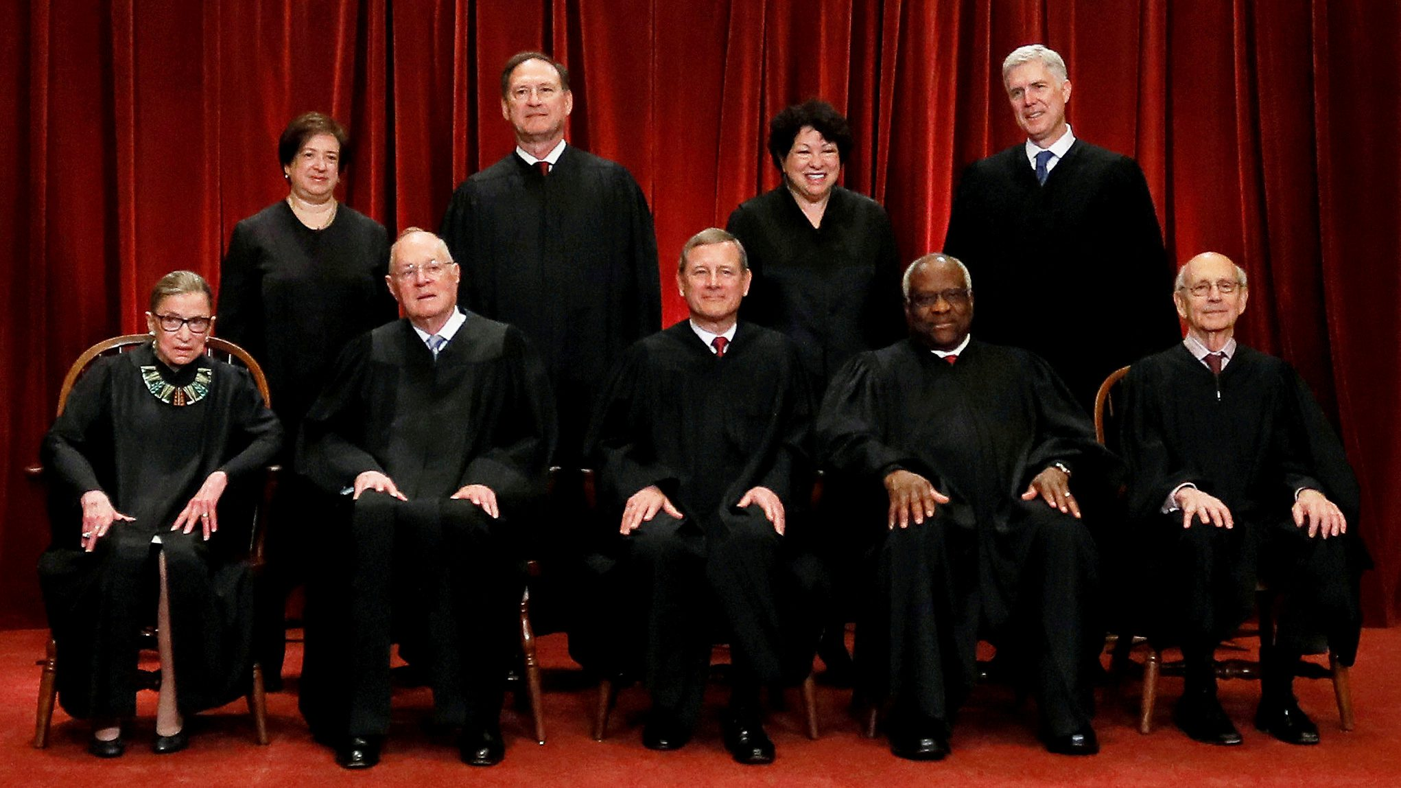 FILE PHOTO: U.S. Chief Justice John Roberts (seated C) leads Justice Ruth Bader Ginsburg (front row, L-R), Justice Anthony Kennedy, Justice Clarence Thomas, Justice Stephen Breyer, Justice Elena Kagan (back row, L-R), Justice Samuel Alito, Justice Sonia Sotomayor, and Associate Justice Neil Gorsuch in taking a new family photo including Gorsuch, their most recent addition, at the Supreme Court building in Washington, DC, U.S. on  June 1, 2017. REUTERS/Jonathan Ernst/File Photo - RC1491C85490