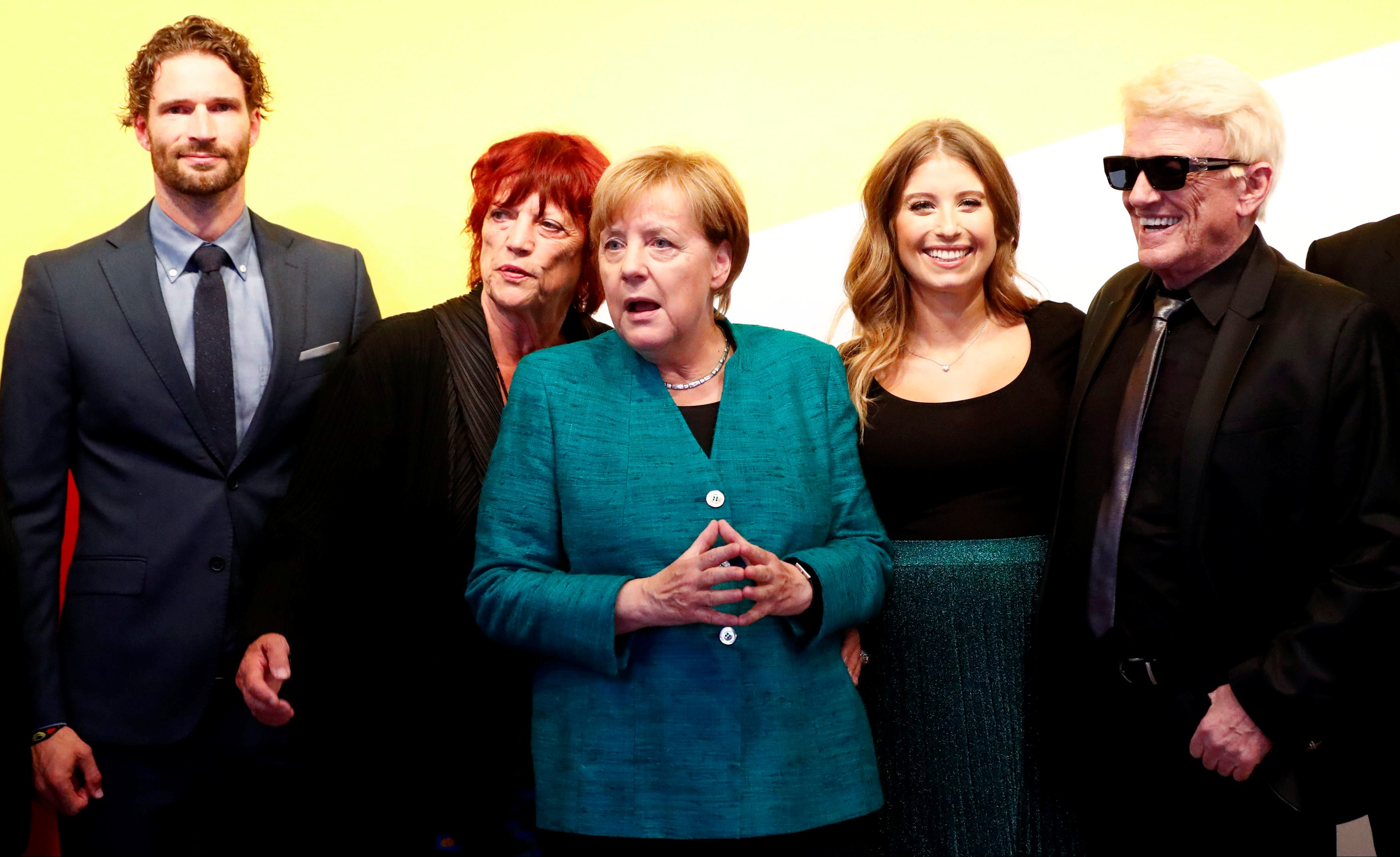 German Chancellor Angela Merkel poses with supporters during a reception at the CDU party election campaign meeting centre in Berlin