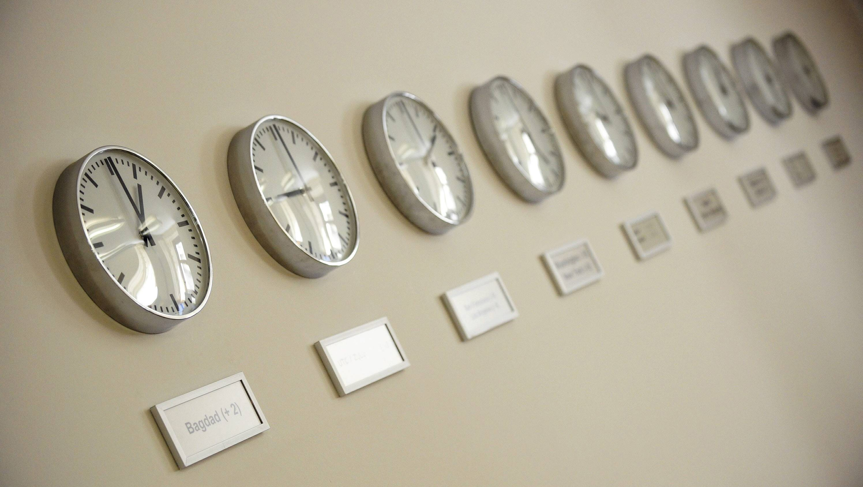 Clocks reading the time in different time zones are pictured on the wall of the crisis committee centre at the Foreign Ministry in Berlin July 15, 2008.