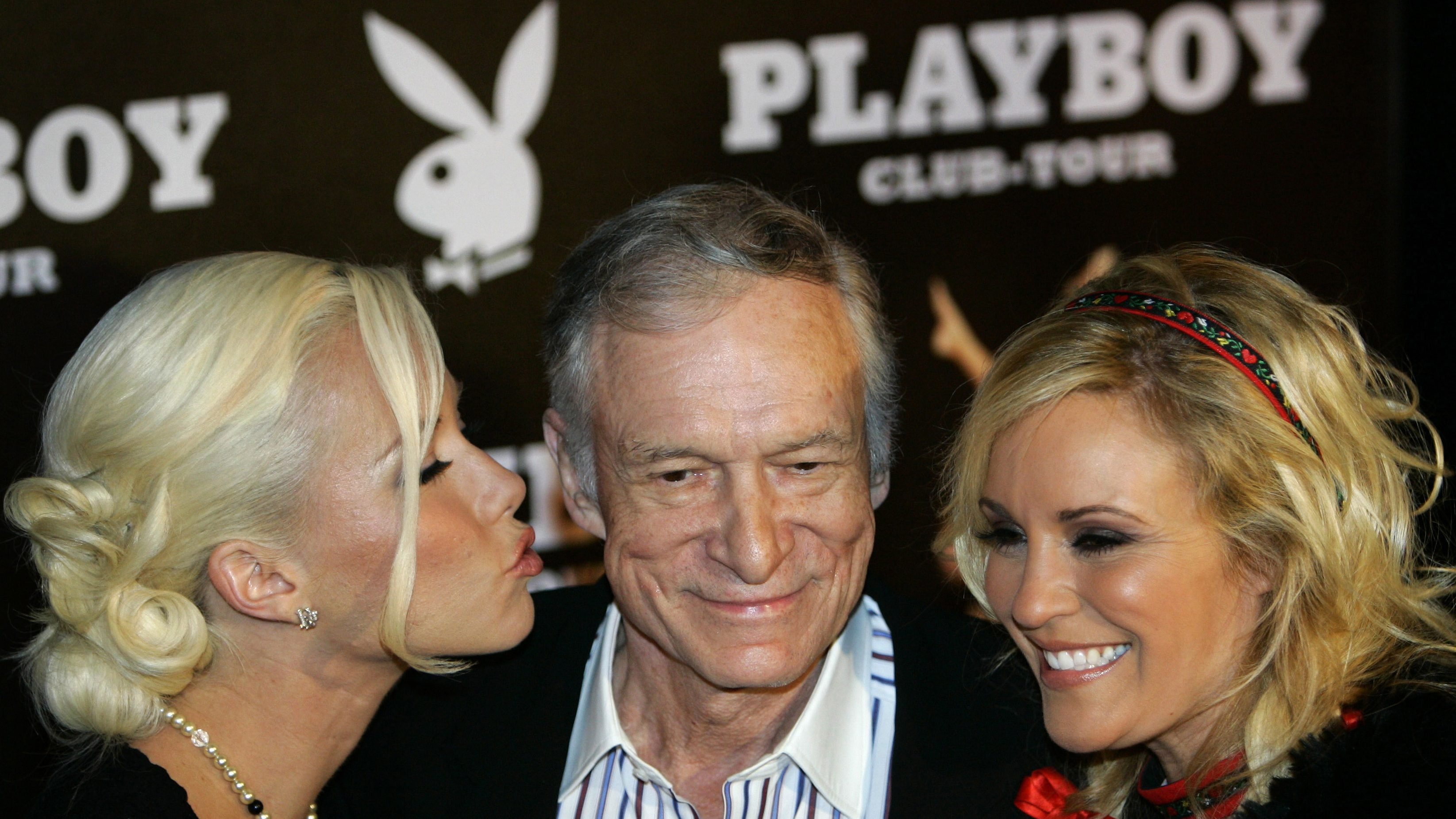 Playboy magazine founder Hugh Hefner arrives with girlfriend Kendra Wilkinson (L) and Bridget Marquardt for his 80th birthday party in Munich's famous club P1 May 31, 2006.