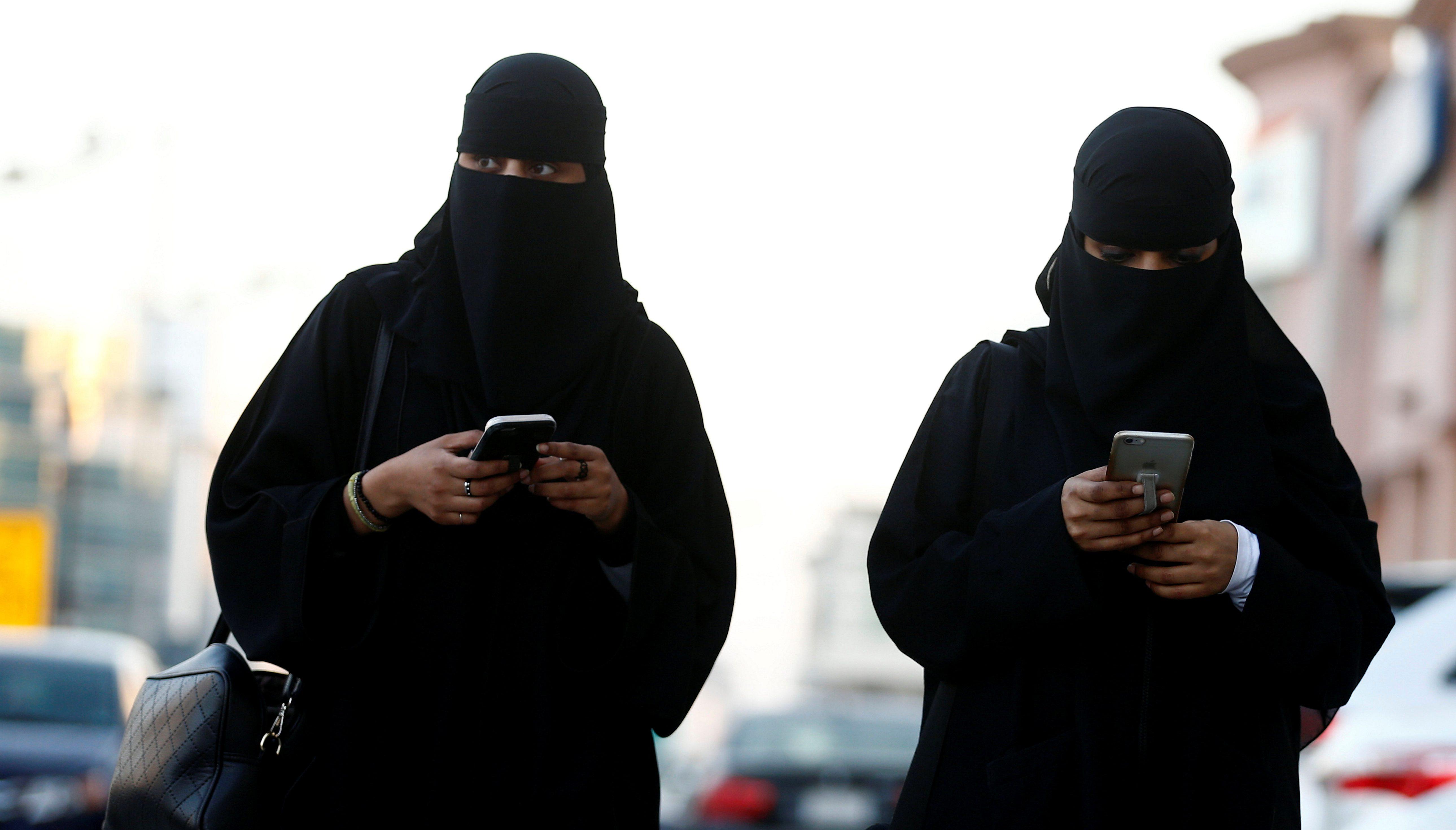 Saudi women use the Careem app on their mobile phones in Riyadh, Saudi Arabia, January 2, 2017. Picture taken January 2, 2017.