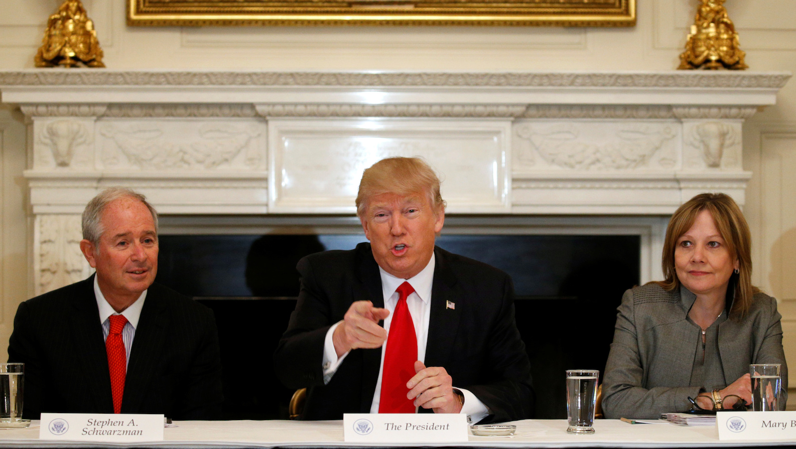 Flanked by Blackstone CEO Stephen Schwarzman (L) and General Motors CEO Mary Barra (R), U.S. President Donald Trump holds a strategy and policy forum with chief executives of major U.S. companies at the White House in Washington, U.S. February 3, 2017.  REUTERS/Kevin Lamarque      TPX IMAGES OF THE DAY - RC1DE01F0800