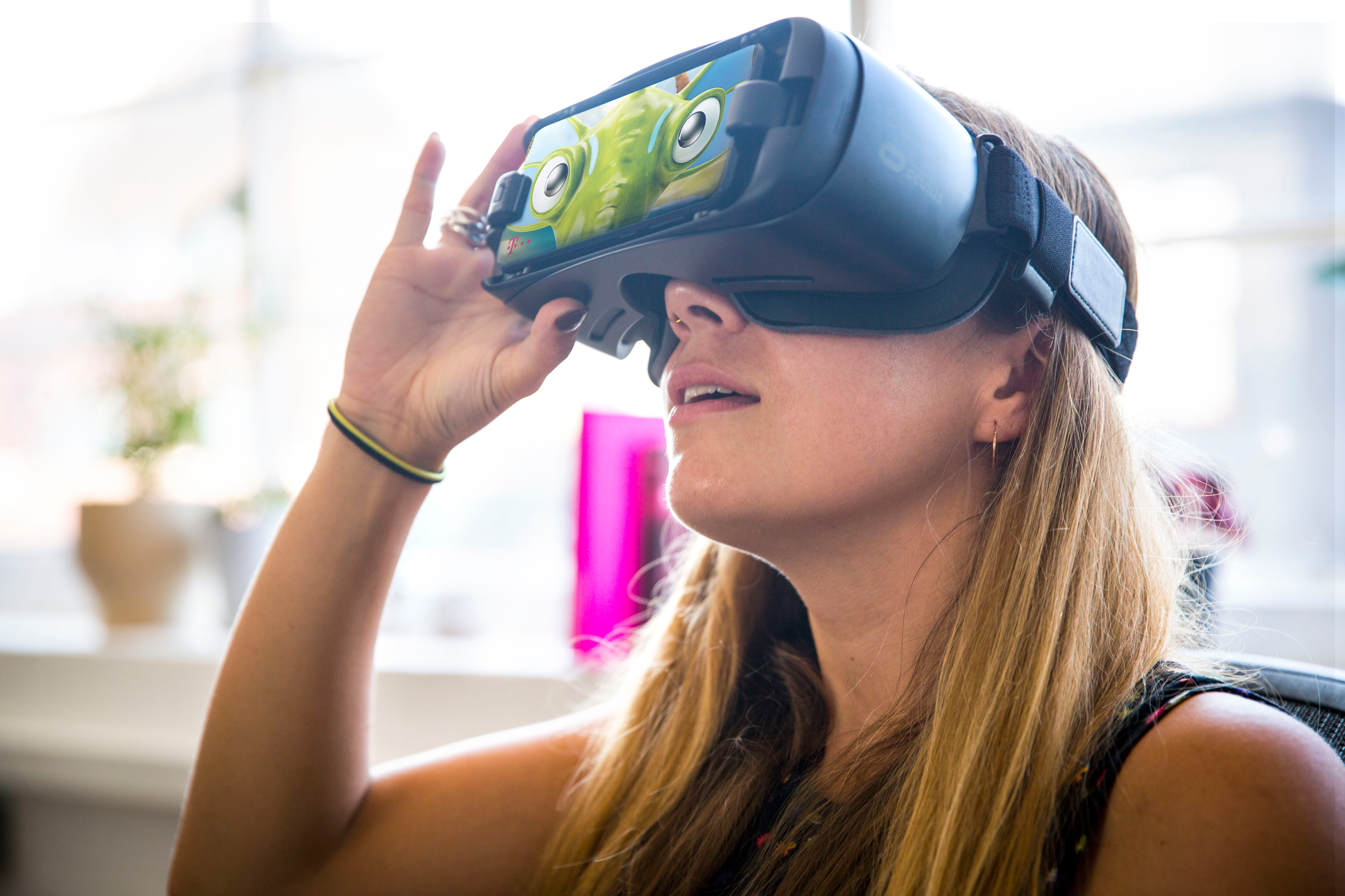 A girl plays the VR game Sea Hero Quest.