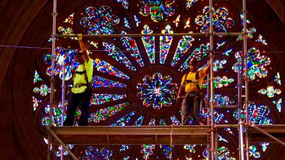 Construction workers repair National Cathedral in Washington DC.