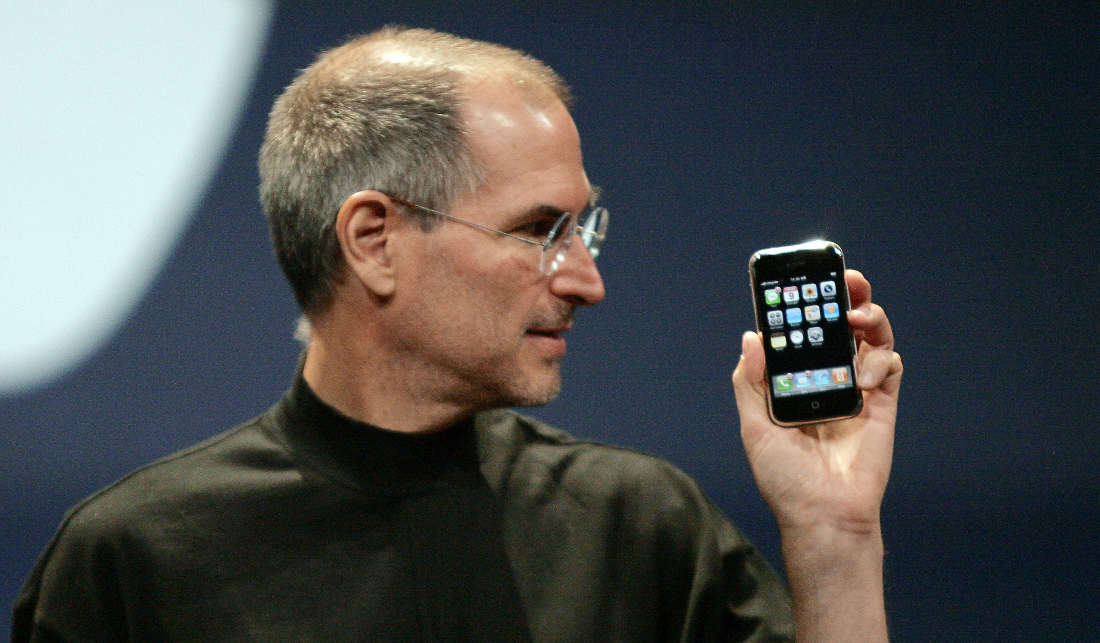 Apple Computer Inc. Chief Executive Officer Steve Jobs holds the new iPhone in San Francisco, California January 9, 2007. Apple unveiled an eagerly-anticipated iPod mobile phone with a touch-screen on Tuesday, priced at $599 for 8 gigabytes of memory, pushing the company's shares up as much as 8.5 percent. Jobs said the iPhone, which also will be available in a 4-gigabyte model for $499, will ship in June in the United States. The phones will be available in Europe in the fourth quarter and in Asia in 2008.  REUTERS/Kimberly White (UNITED STATES) FOR BEST QUALITY IMAGE SEE: GM1E7AE0B8F01 - GM1DUITMLKAA
