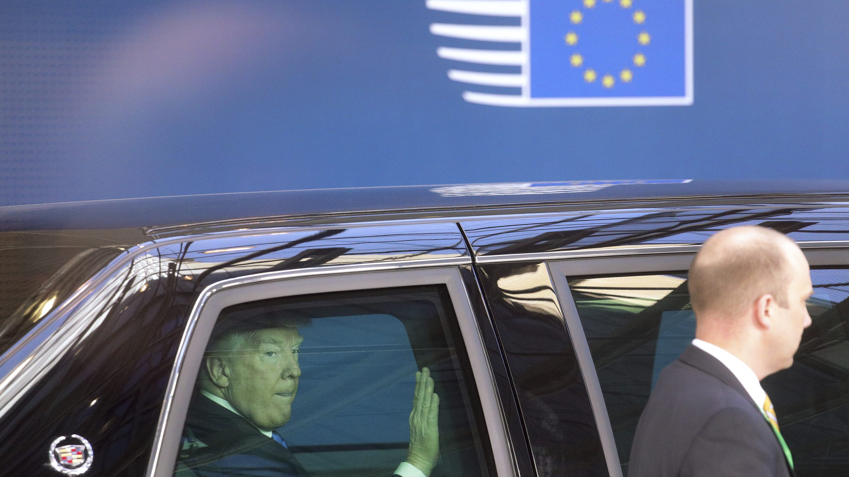 US President Donald Trump leaves the Europa building in Brussels after meeting EU officials Thursday, May 25, 2017. US President Donald Trump arrived in Belgium Wednesday evening and will attend a NATO summit as well as meet EU and Belgian officials. (AP Photo/Olivier Matthys)