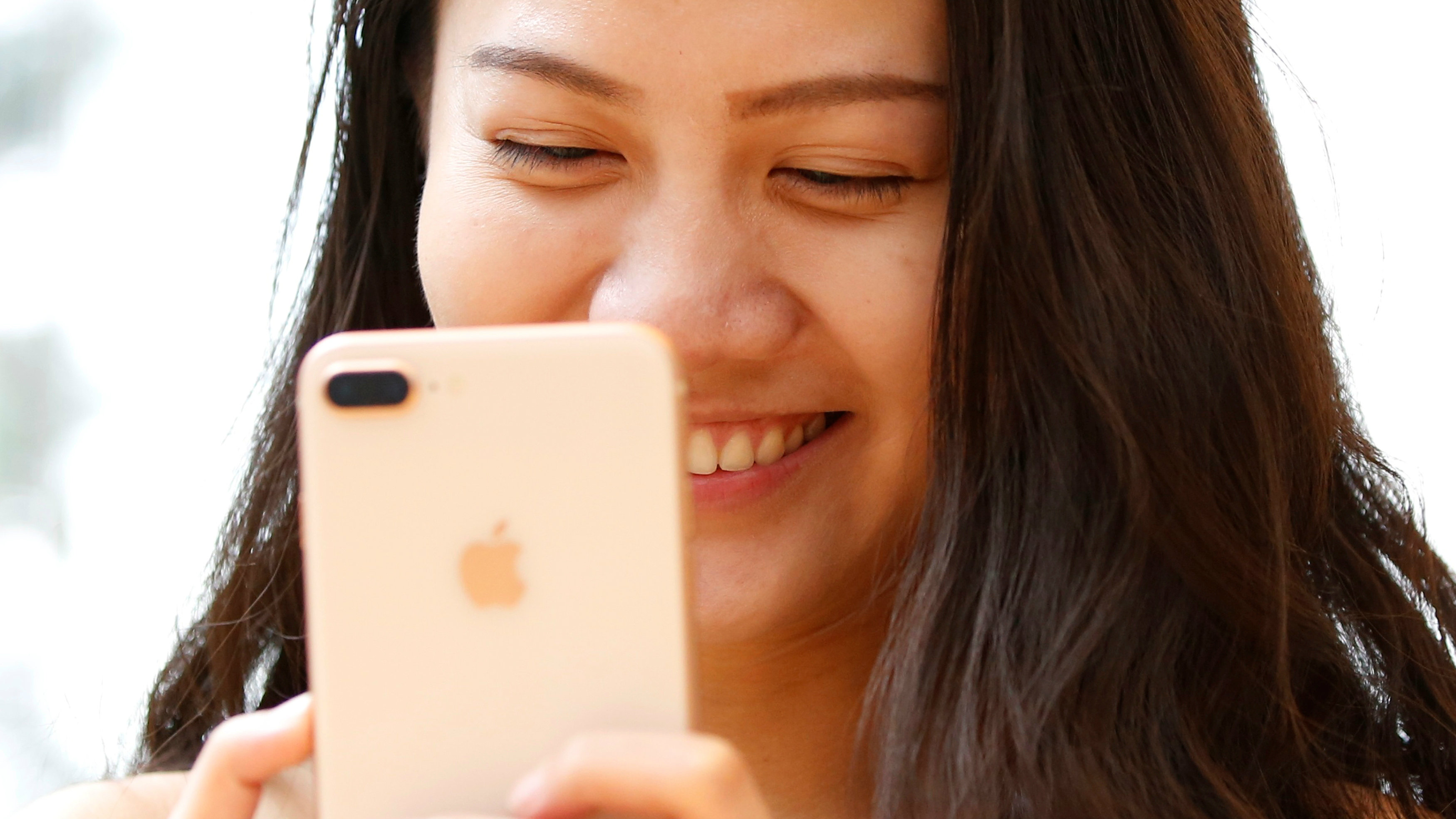 A woman holds Apple's new iPhone 8 Plus after it went on sale at the Apple Store in Tokyo's Omotesando shopping district, Japan, September 22, 2017.