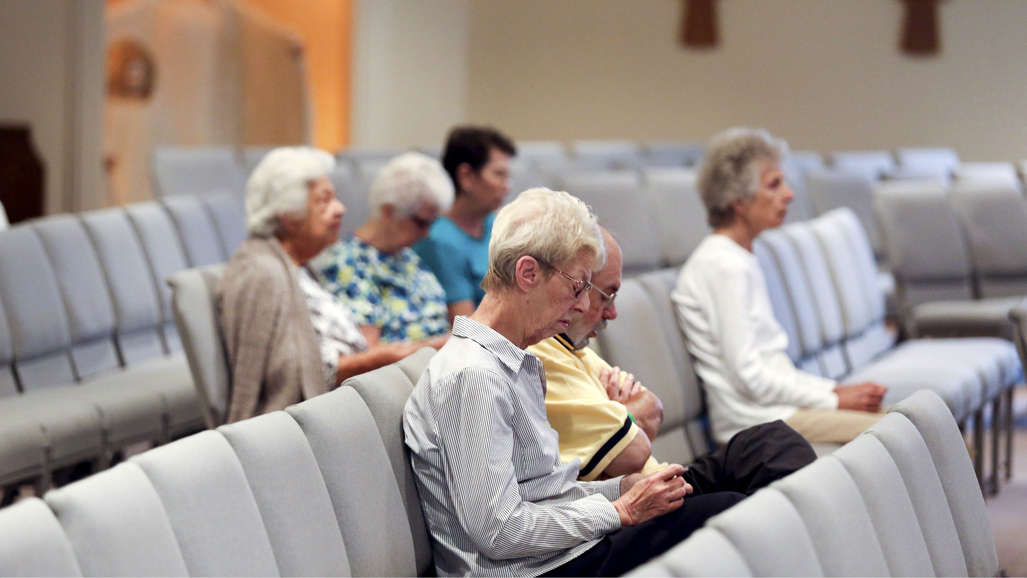 """Parishioners pray the rosary before a mass for killed journalists Alison Parker and Adam Ward at Resurrection Catholic Church in Moneta, Virginia August 27, 2015. Reporter Parker, 24, and cameraman Ward, 27, were shot to death during a live broadcast in Virginia on Wednesday, slain by a former employee of the TV station and who called himself a """"powder keg"""" of anger over what he saw as racial discrimination at work and elsewhere in the United States. The suspect, 41-year-old Vester Flanagan, shot himself as police pursued him on a Virginia highway hours after the shooting. Flanagan, who was African-American, died later at a hospital, police said"""