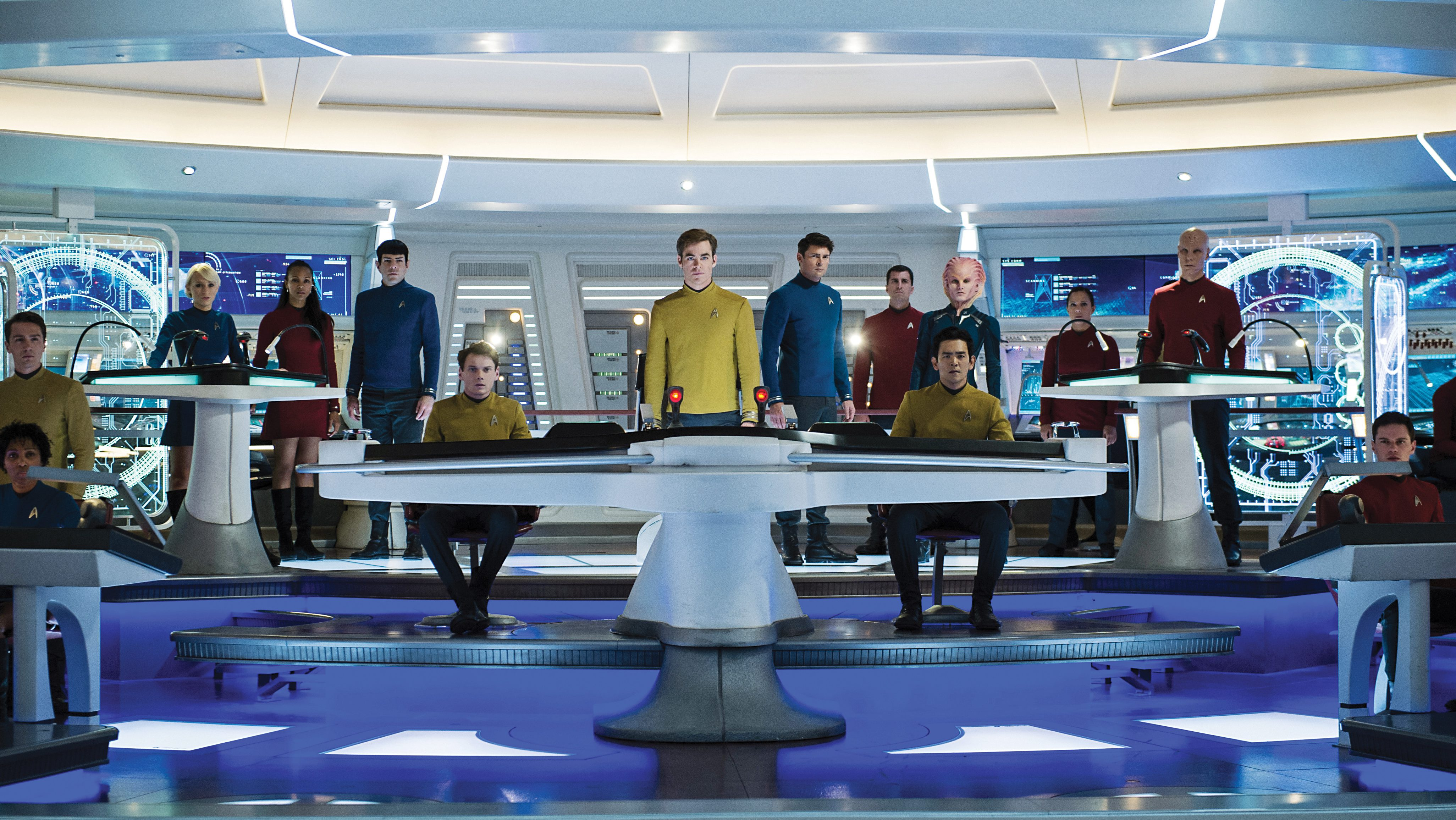 Left to right: Polina Nikolai plays USSE Bridge Crew, Zoe Saldana plays Lieutenant Uhura, Zachary Quinto as Commander Spock, Anton Yelchin as Chekov, Chris Pine as Captain James T. Kirk, Karl Urban plays Doctor 'Bones' Mccoy, John Cho plays Sulu, Lydia Wilson plays Kalara and Christian Sloan plays Jae in Star Trek Beyond from Paramount Pictures, Skydance, Bad Robot, Sneaky Shark and Perfect Storm Entertainment