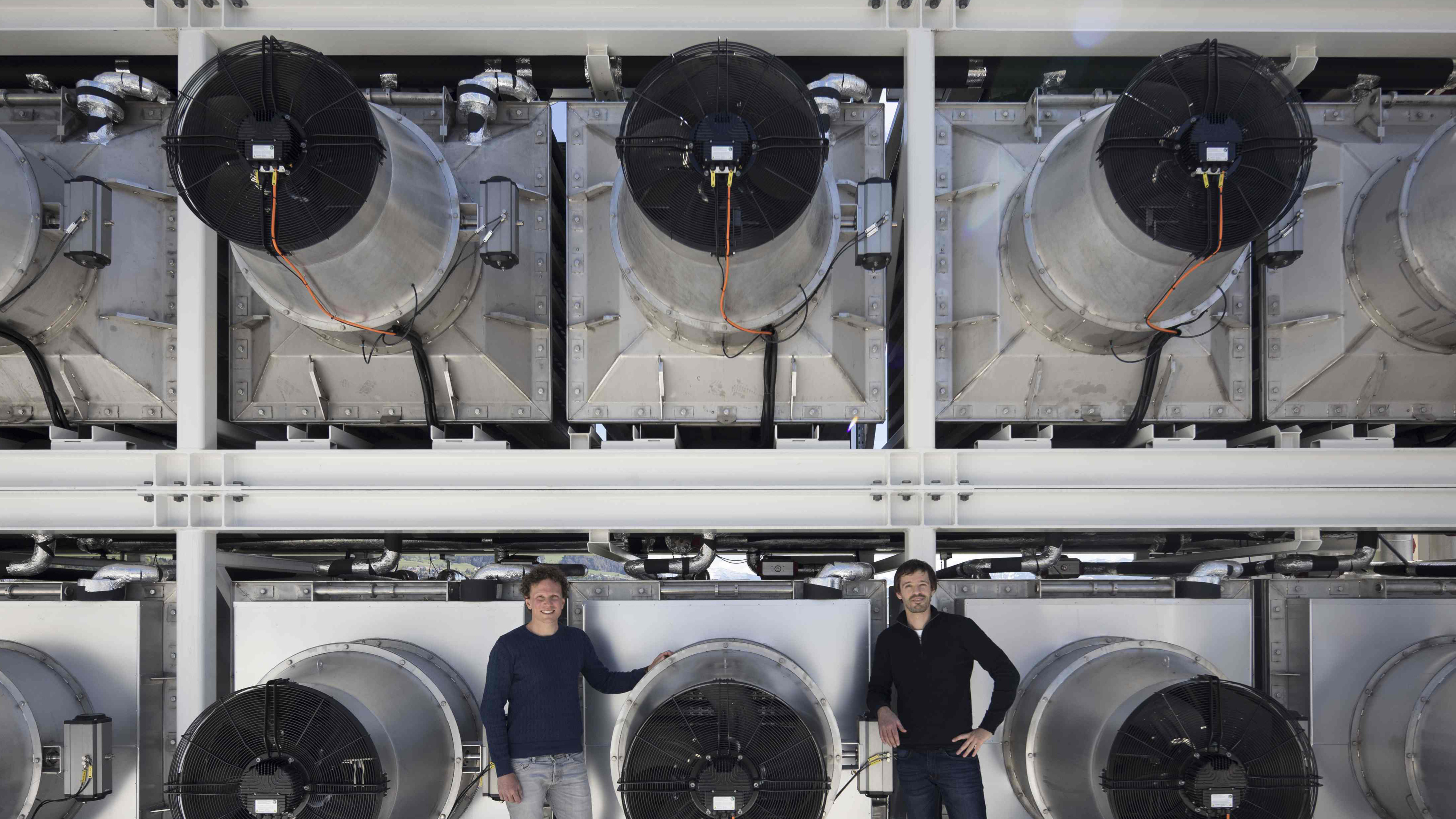 Founders Christopha Gebald and Jan Wurzbacher stand next to Climeworks CO2 capture plant in Hinwil, Canton of Zurich, Switzerland. Climeworks sells and transports the CO2 to the neighbouring company which uses it for their greenhouses.
