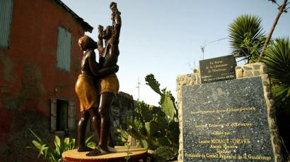 A statue commemorating freedom from slavery stands outside the Slave House on Goree Island, Senegal August 17, 2006. An unknown number of slaves were shipped from here to French colonies in the Caribbean between the mid-16th and 19th centuries. The International Day for the Remembrance of the Slave Trade and its Abolition is celebrated on August 23.