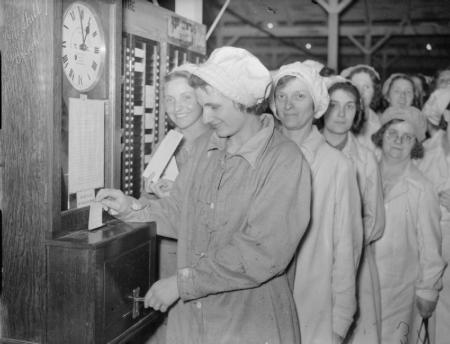 Women punching in at a munitions factory