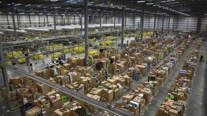 Workers collect customer orders during Black Friday deals week at an Amazon fulfilment centre in Hemel Hempstead