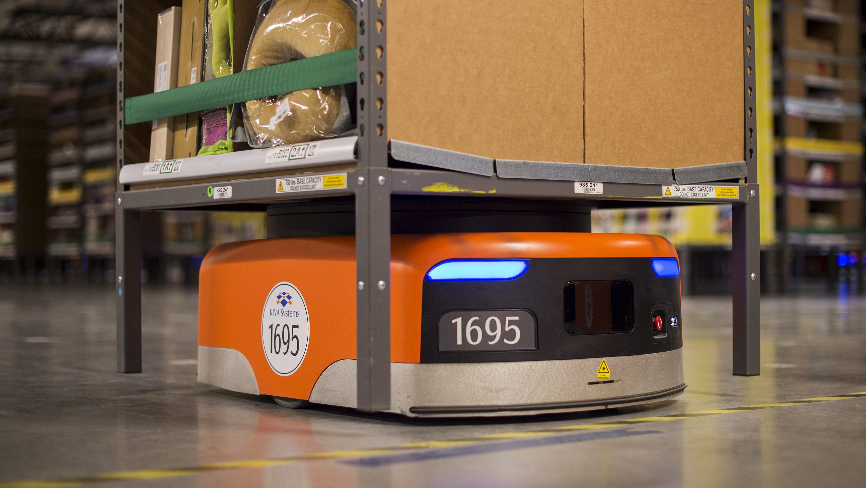 A Kiva robot moves inventory at an Amazon fulfillment center in Tracy, California December 1, 2014.