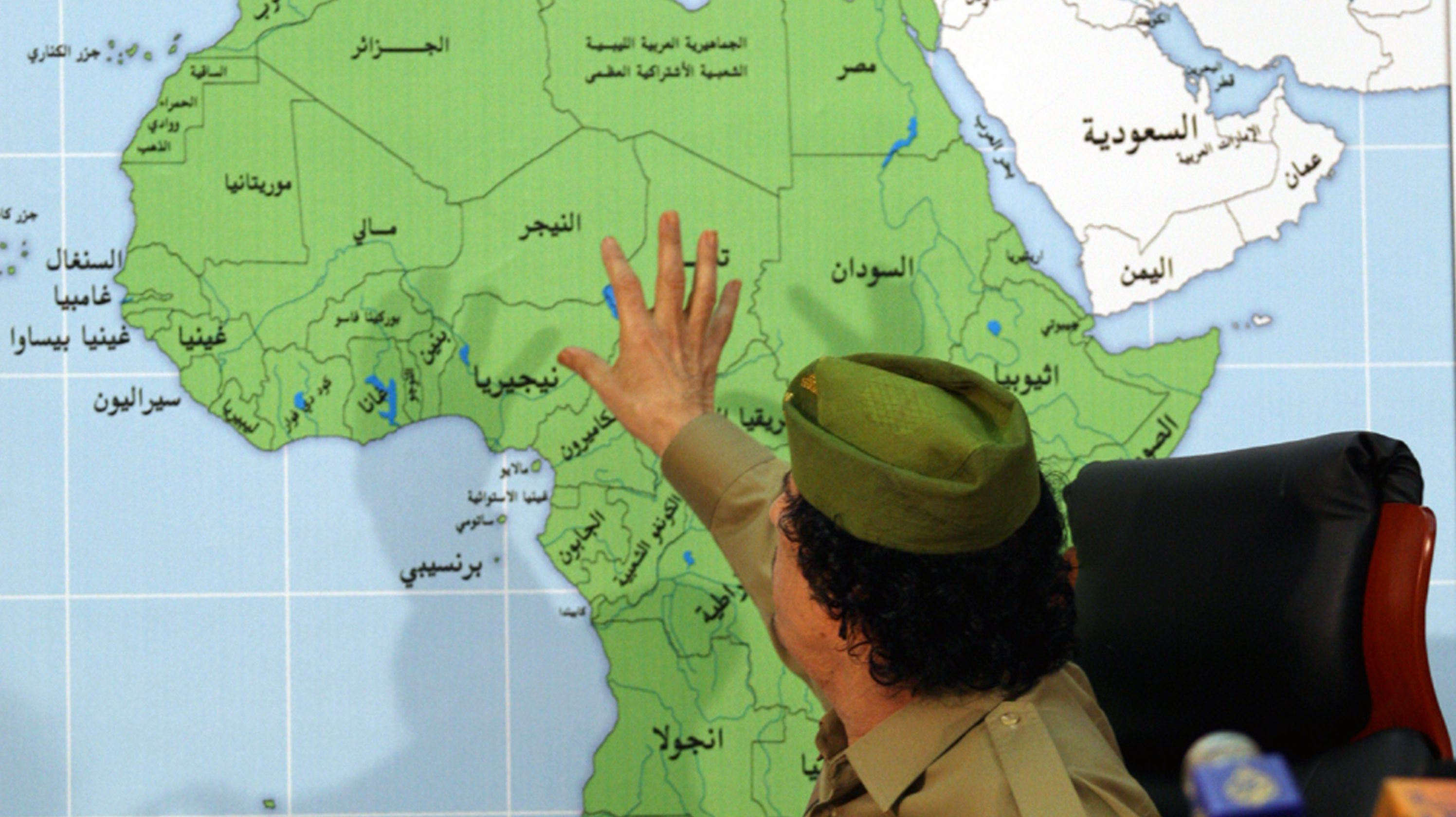 Libyan leader Moammar Gadhafi talks during a press conference in front of Africa map in Tripoli, Libya, Tuesday, Jan. 29, 2008.