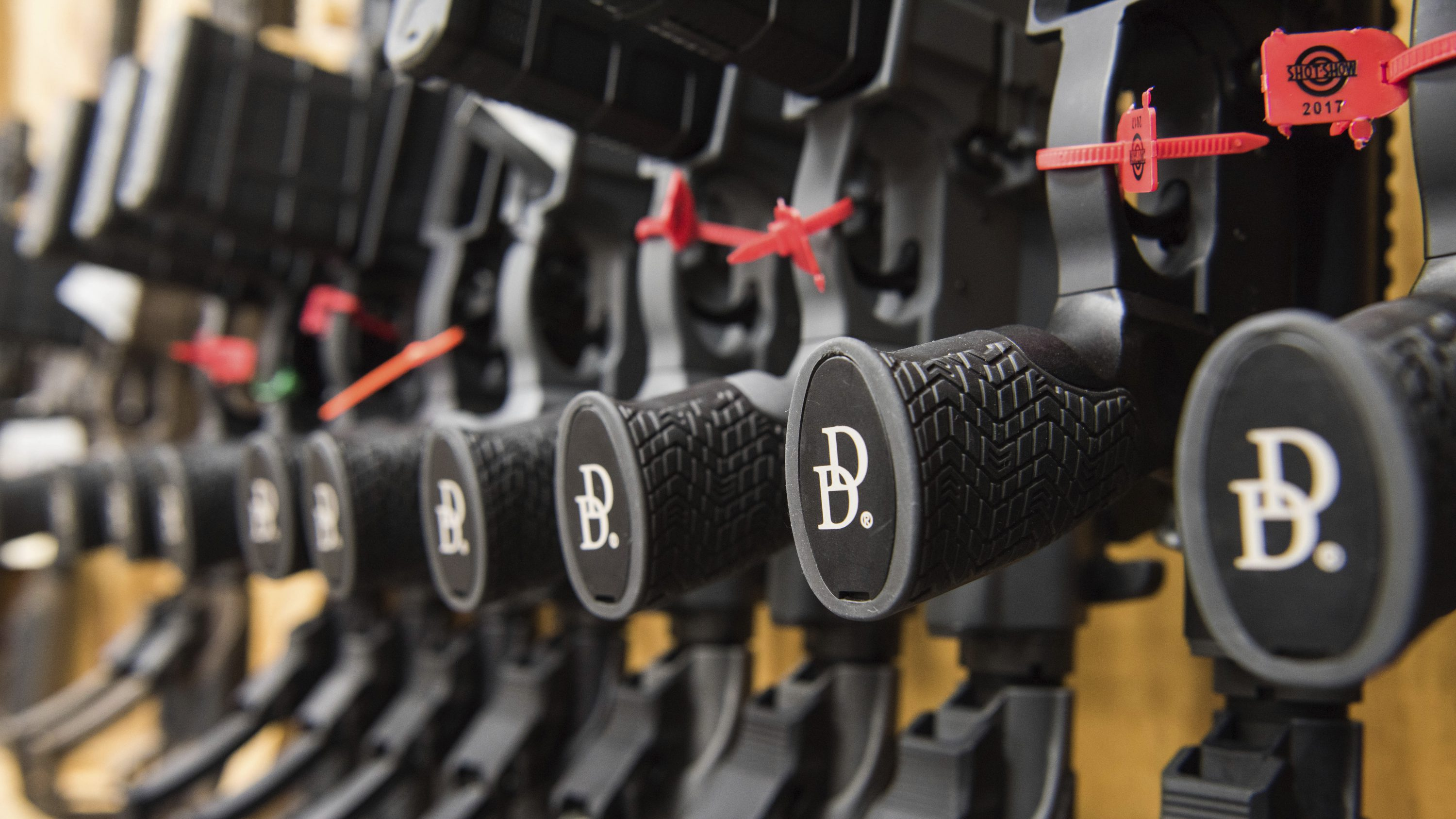 A photo of a row of AR-15 style rifles manufactured by Daniel Defense in a vault at the company's headquarters in Black Creek, Ga.