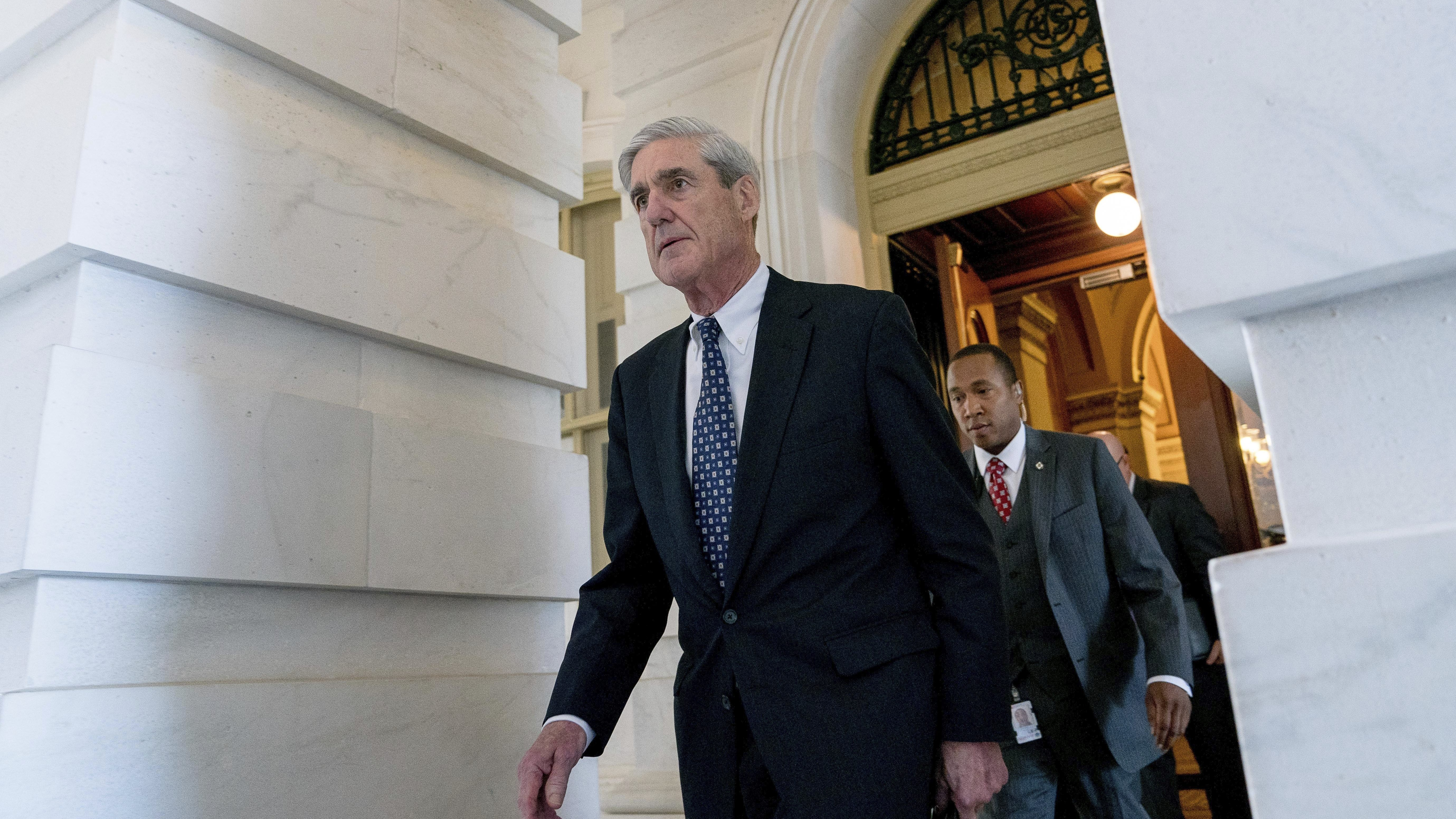 In this June 21, 2017 photo, Special Counsel Robert Mueller departs Capitol Hill following a closed door meeting in Washington. Mueller's team of investigators is in possession of a letter drafted by President Donald Trump and an aide, but never sent, that lays out a rationale for firing FBI Director James Comey, according to a person familiar with the investigation.  (AP Photo/Andrew Harnik)
