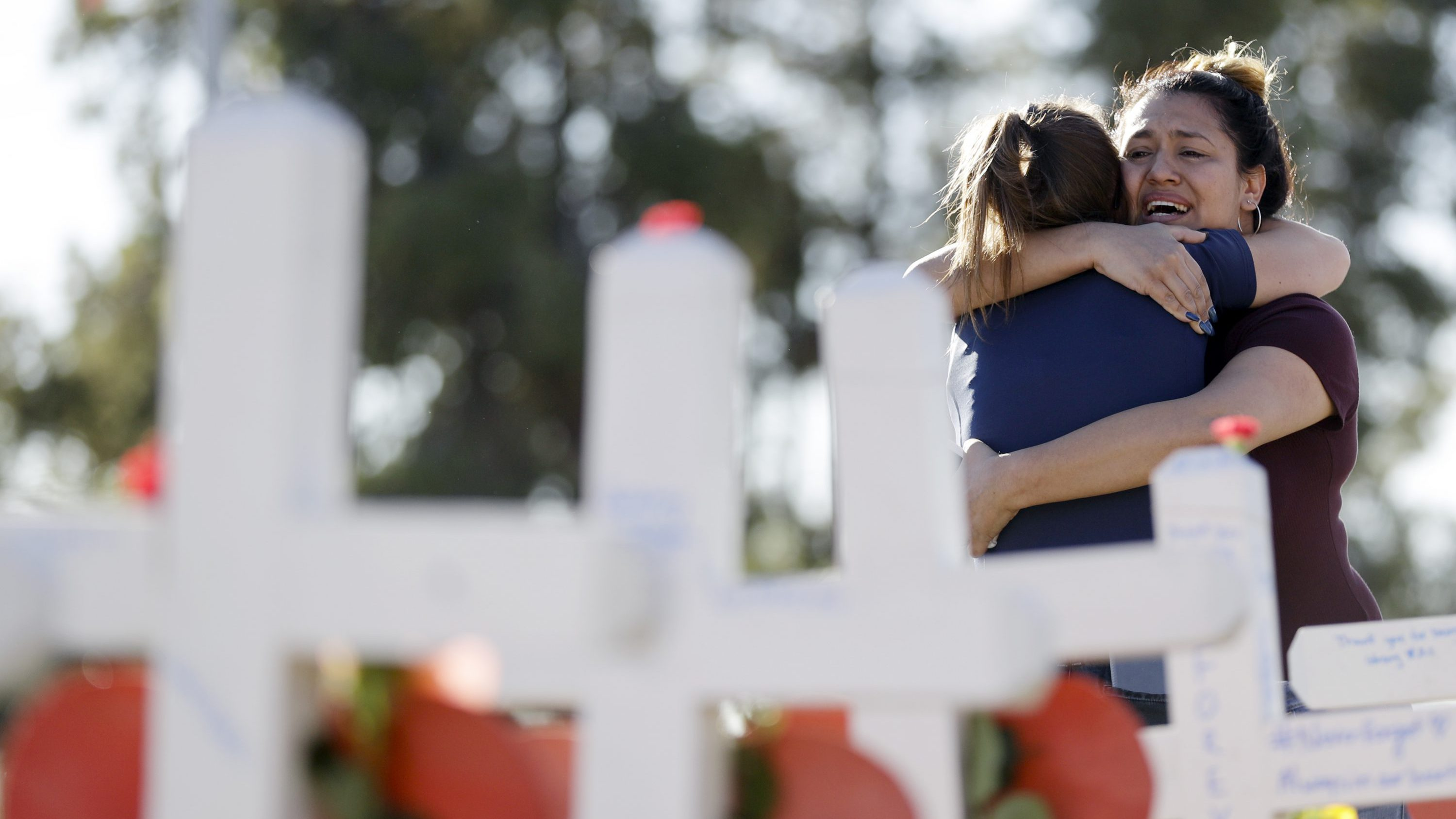 Melissa Gerber, left, hugs Sandra Serralde, both of Las Vegas, as they visit crosses placed in honor of those killed in the mass shooting Friday, Oct. 6, 2017, in Las Vegas. A gunman opened fire on an outdoor music concert on Sunday killing dozens and injuring hundreds.
