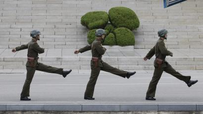 North Korean soldiers march in the border village of Panmunjom